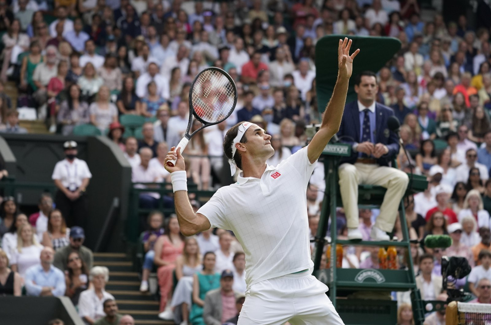 Switzerland's Roger Federer serves to Richard Gasquet of France during the men's singles second round match on day four of the Wimbledon Tennis Championships in London, July 1, 2021. (AP Photo)