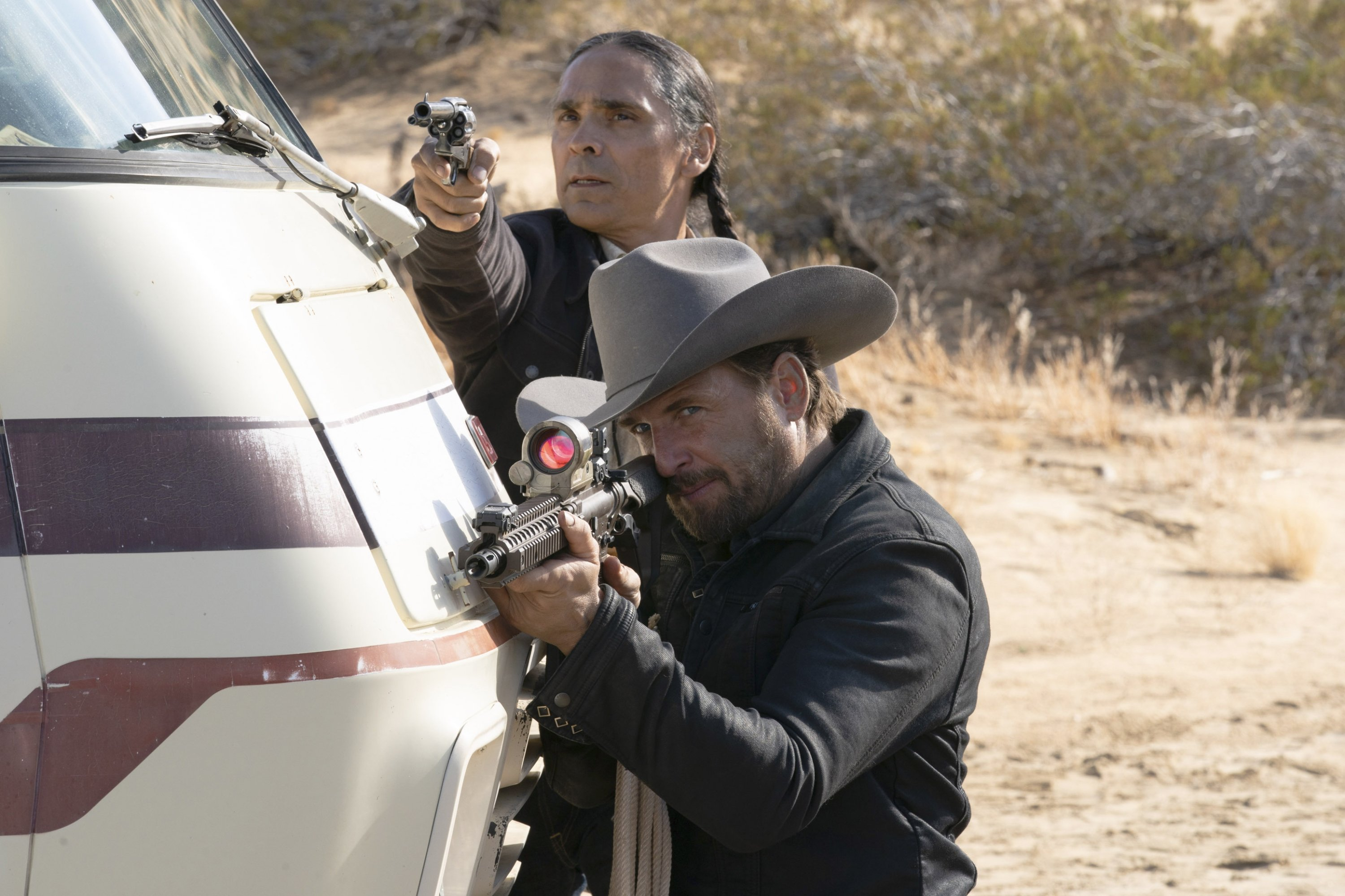 Josh Lucas (front) and Zahn McClarnon aim their weapons in a scene from 'The Forever Purge,' directed by Everardo Valerio Gout. (Universal Pictures via AP)