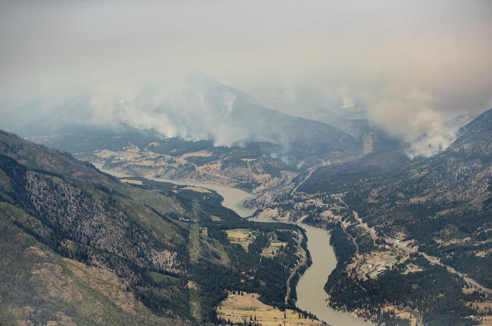 In this aerial photo taken from a helicopter, a wildfire burns in the mountains north of Lytton, British Columbia, July 1, 2021. (The Canadian Press via AP)