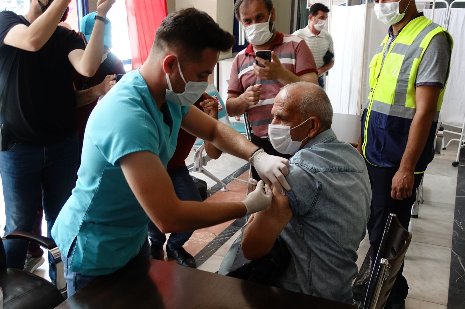 A man gets vaccinated at a vaccination spot at a train station in Konya, central Turkey, July 2, 2021. (AA PHOTO)