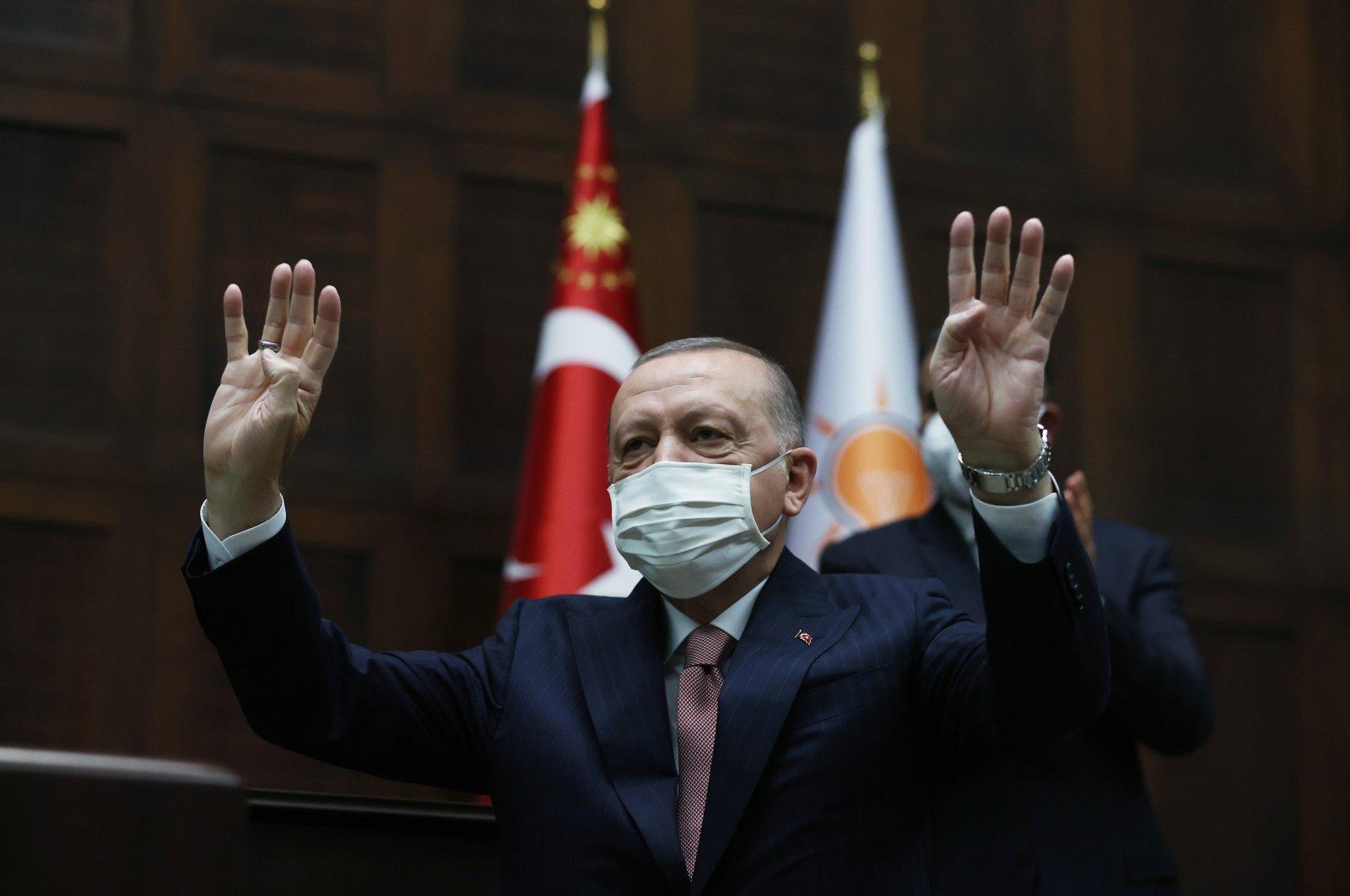 President Recep Tayyip Erdoğan salutes AK Party members during a meeting in capital Ankara, Turkey, June 30, 2021. (AA Photo)