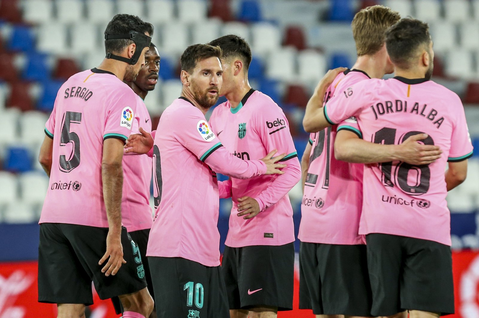 Barcelona players celebrate a goal during a La Liga match against Levante, in Valencia, Spain, May 11, 2021. Barcelona is known for its tiki-taka play style, which involves frequent short passes. (AP Photo)