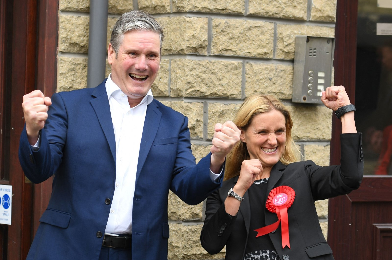 Britain's main opposition Labour Party leader Keir Starmer (L) and Labour Party's Kim Leadbeater celebrate victory outside the campaign center following the Batley and Spen by-election in Cleckheaton, West Yorkshire on July 2, 2021. (AFP Photo)