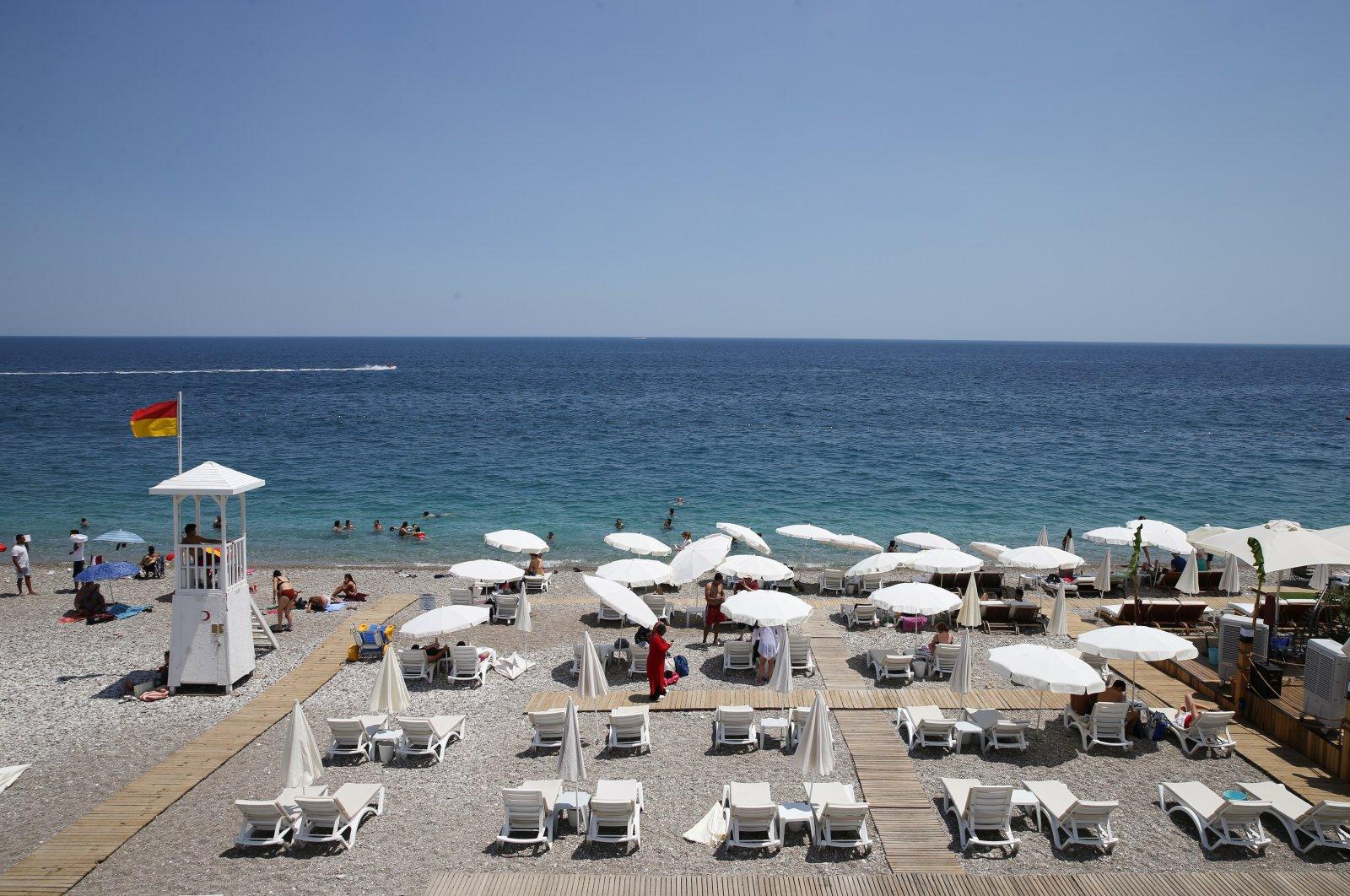People enjoy the hot weather at Konyaaltı beach, Antalya, southern Turkey, June 28, 2021. (AA Photo)