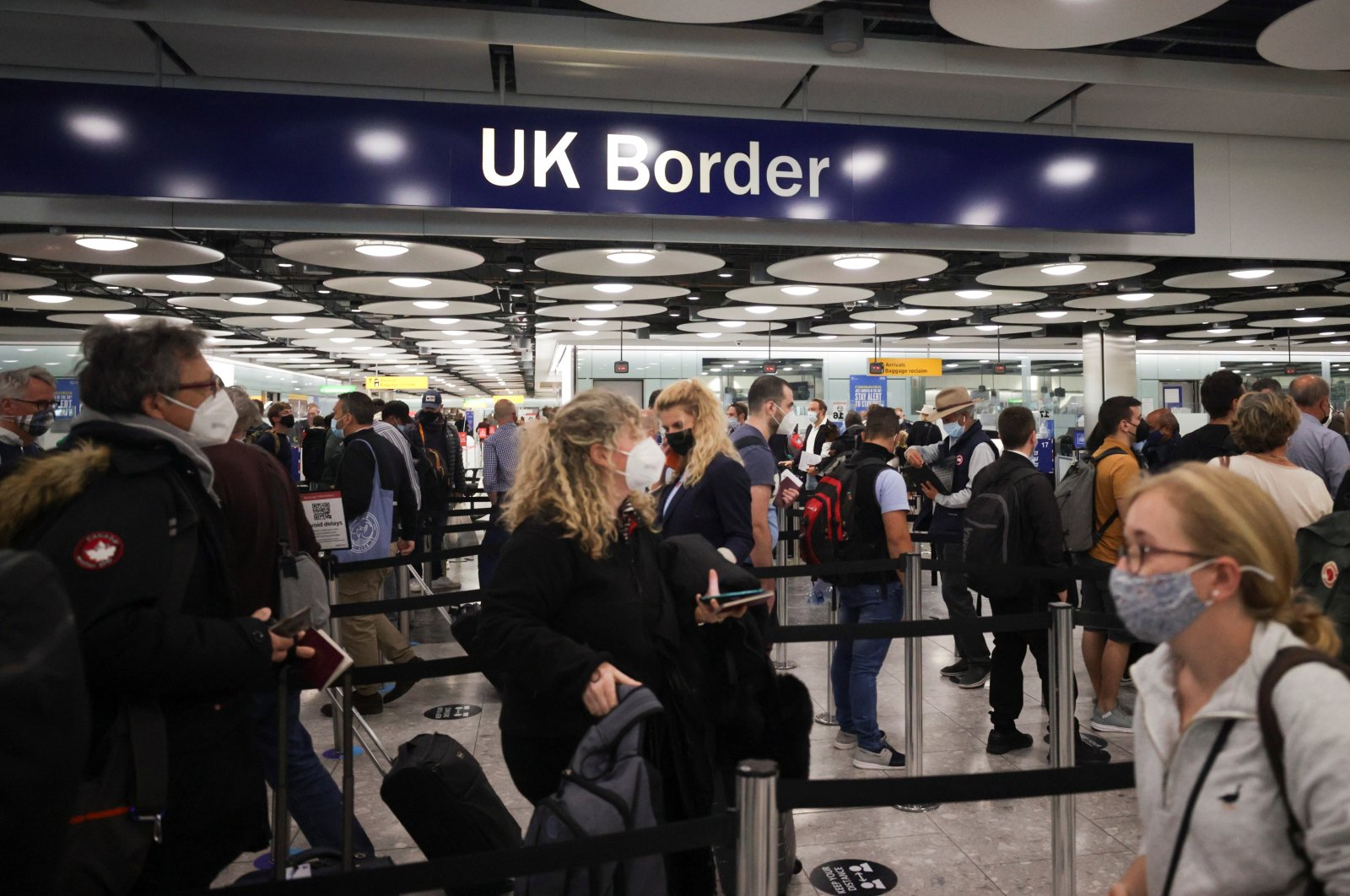 Arriving passengers wait in line at the UK Border Control at Terminal 5 of Heathrow Airport in London, Britain June 29, 2021. (Reuters Photo)