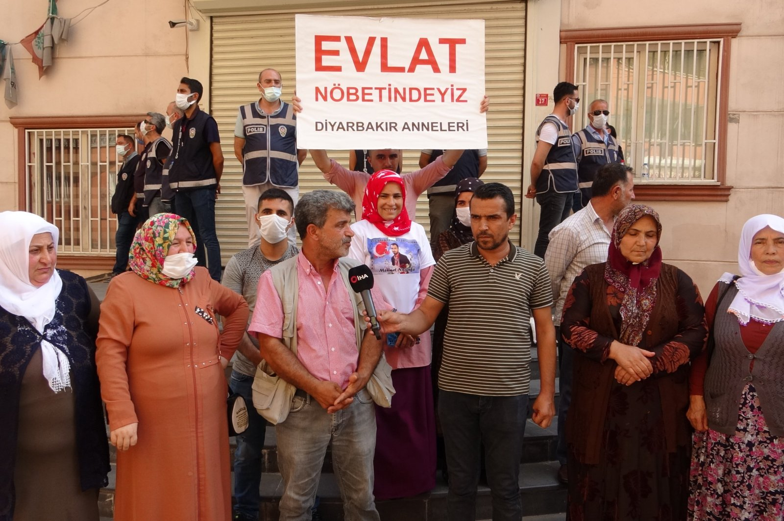 Families make a press statement after CHP lawmaker fails to visit them in front of the HDP headquarters in Diyarbakır, July 2, 2021. (IHA Photo)