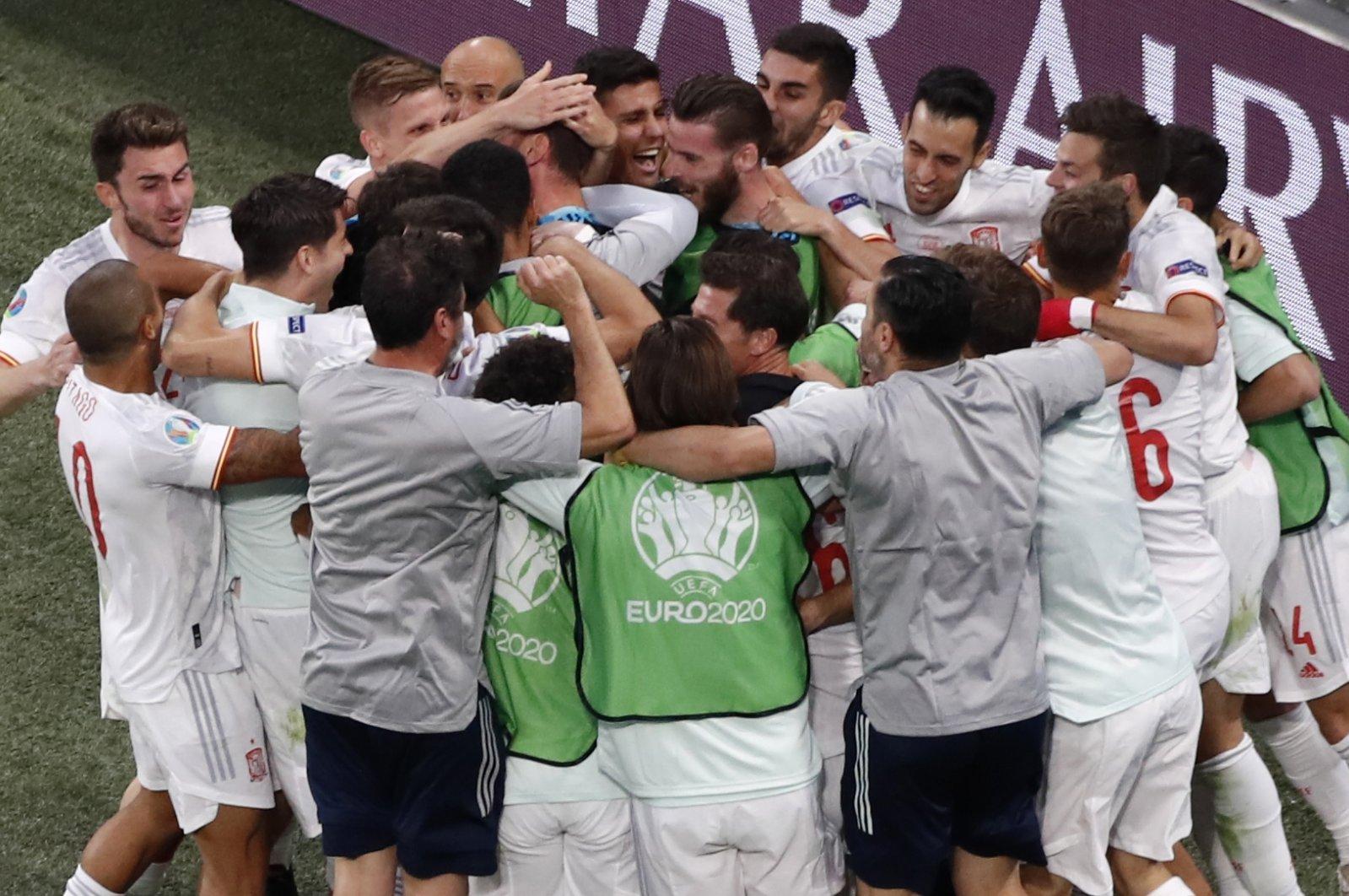 Spain's team celebrates after winning the Euro 2020 football championship quarterfinal match between Switzerland and Spain at Saint Petersburg Stadium in Saint Petersburg, Russia, July 2, 2021. (AP Photo)