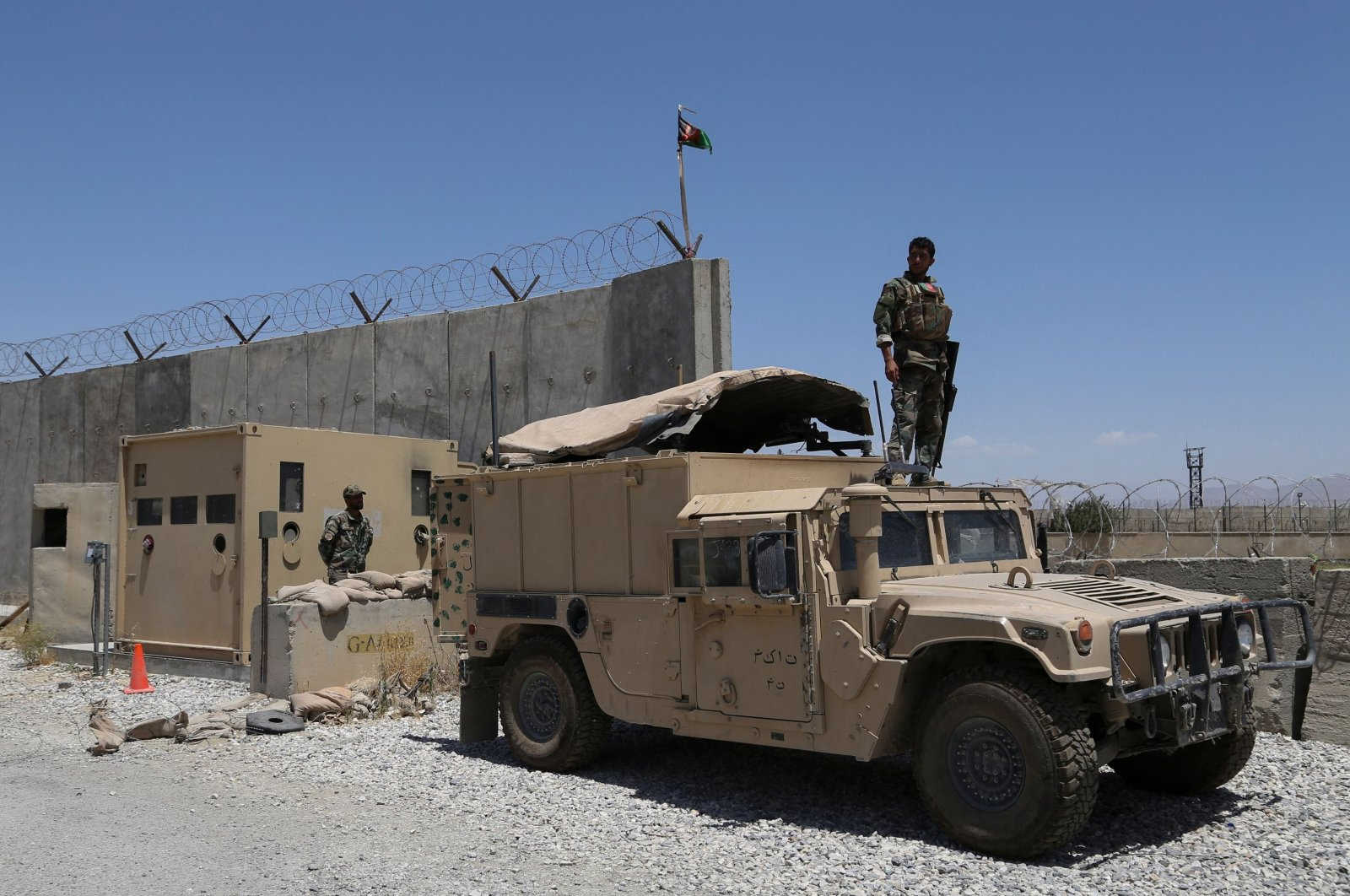 An Afghan National Army (ANA) soldier looks out while standing on a Humvee vehicle at Bagram Air Base after all U.S. and NATO troops left, some 70 km north of Kabul, July 2, 2021. (AFP Photo)