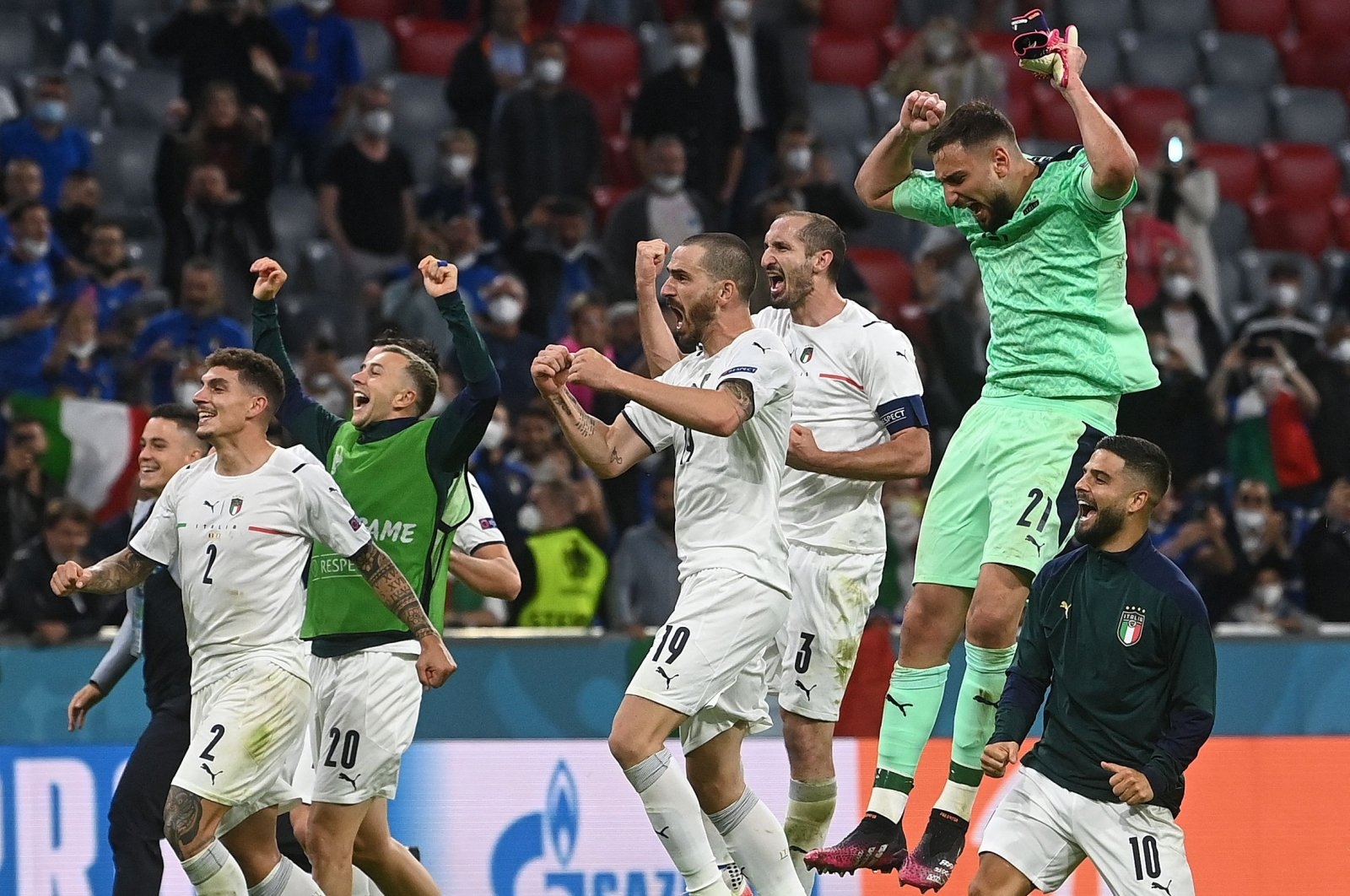 Italy's players celebrate victory after the UEFA Euro 2020 quarter-final football match between Belgium and Italy at the Allianz Arena in Munich, Germany, July 2, 2021. (AFP Photo)