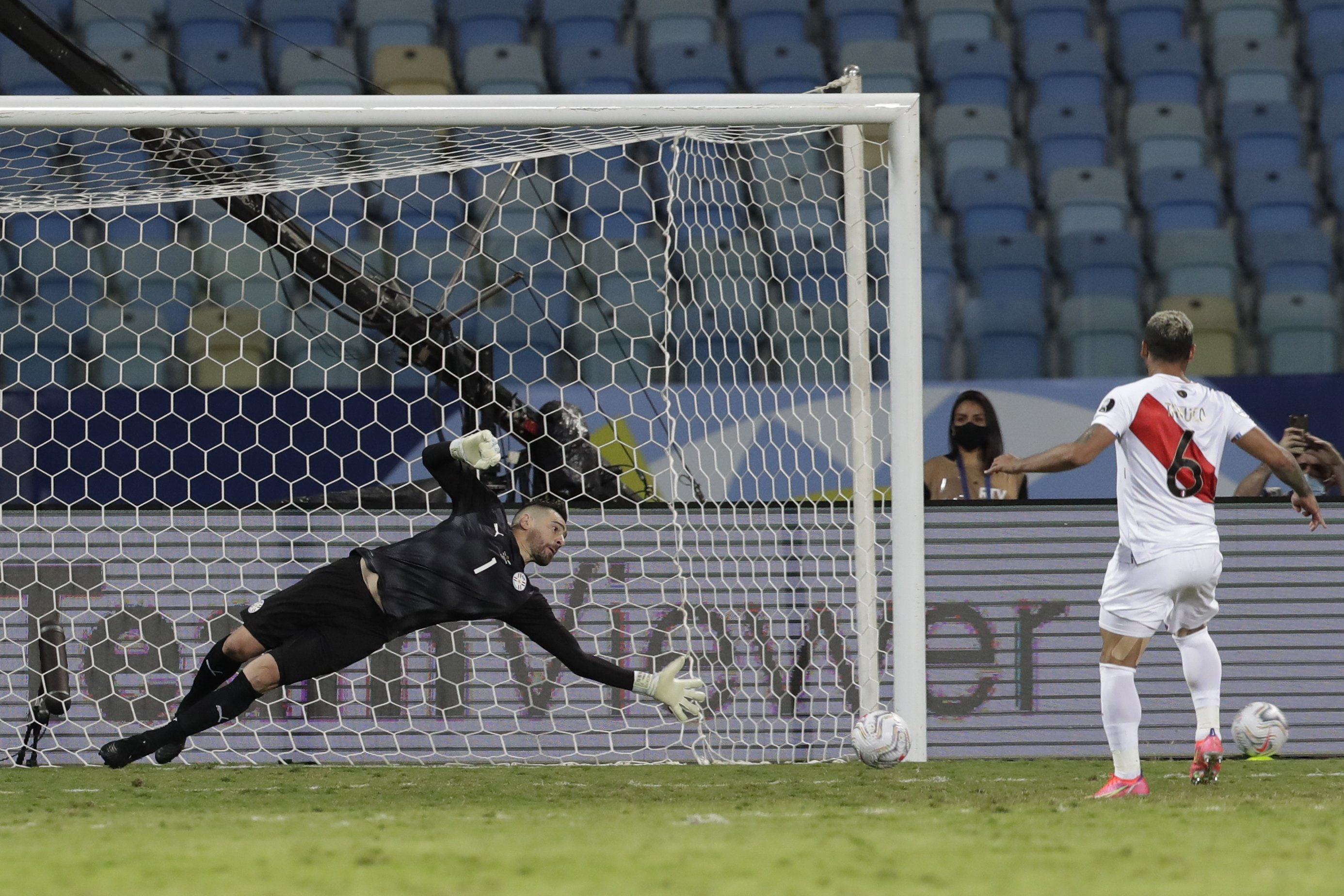Peru's Miguel Trauco scores is side's winning goal in a penalty shootout during a Copa America quarterfinal football match at Olimpico stadium in Goiania, Brazil, July 2, 2021. (AP Photo)