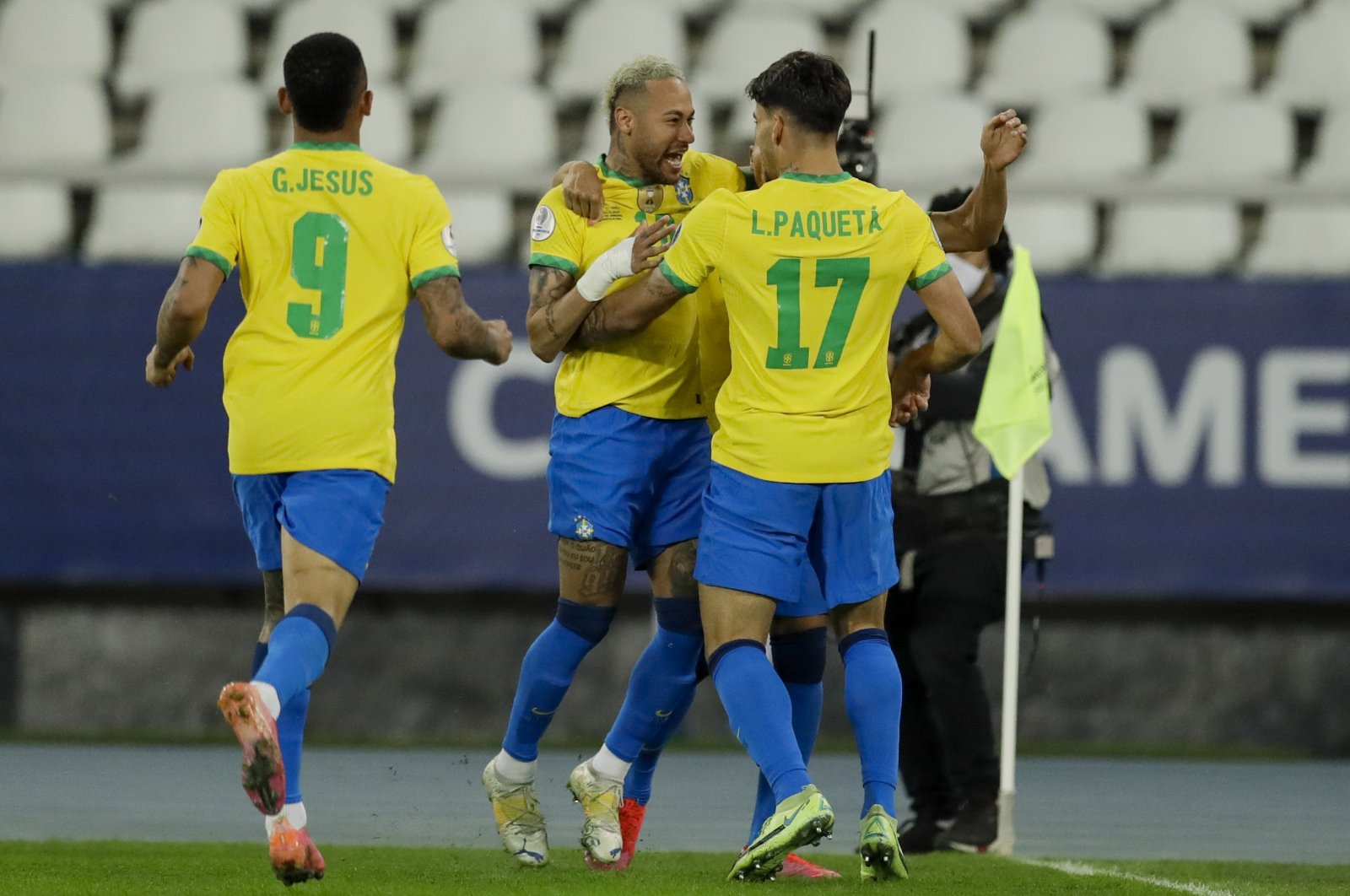 Brazil's Lucas Paqueta celebrates with teammate Neymar after scoring the only goal during a Copa America quarterfinal football match against Chile at the Nilton Santos stadium in Rio de Janeiro, Brazil, July 2, 2021. (AP Photo)
