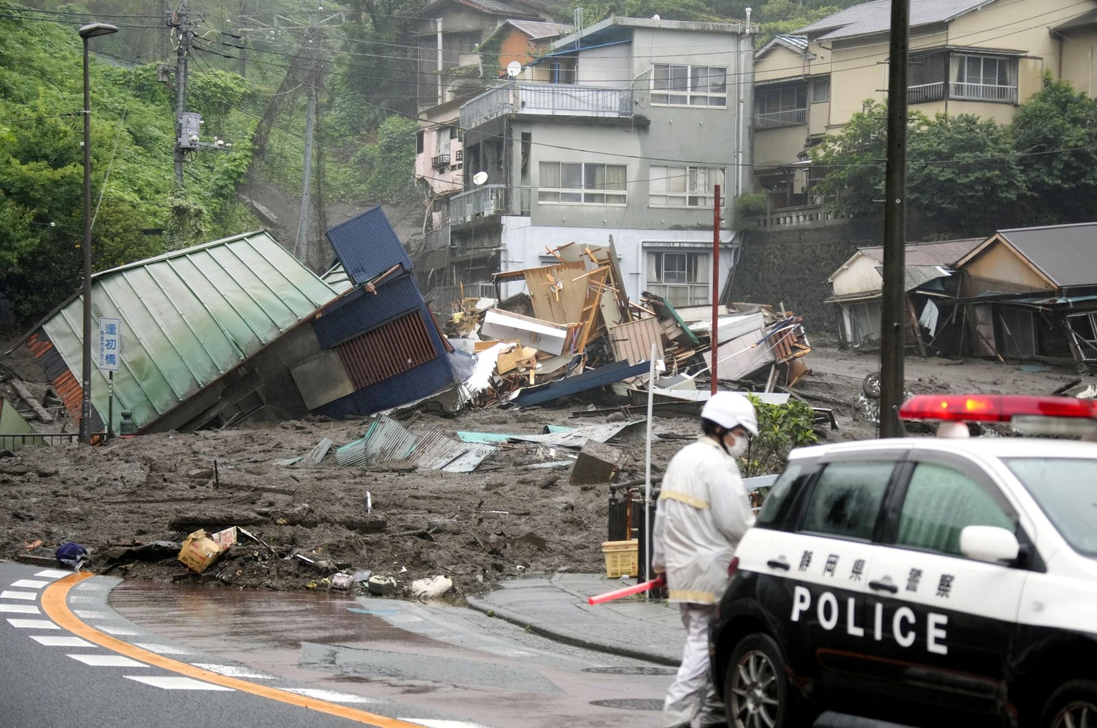 Houses damaged by a mudslide are seen following heavy rain at Izusan district in Atami, Japan July 3, 2021. (Kyodo via Reuters)
