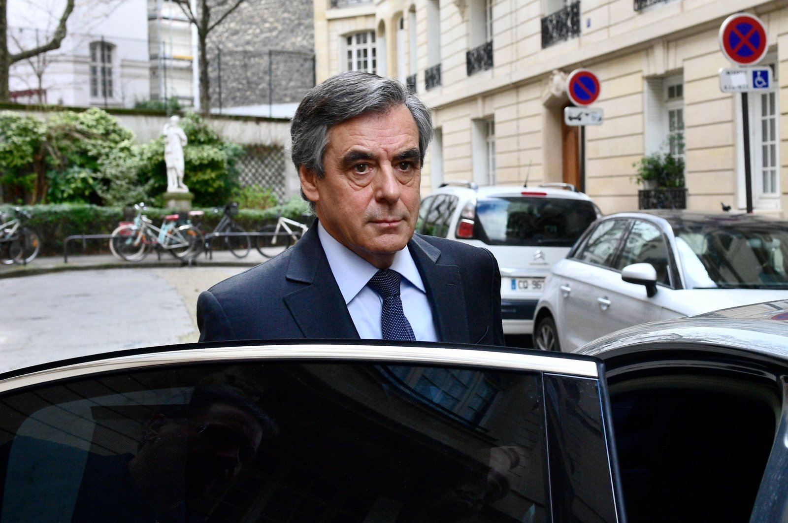 In this file photo taken on February 24, 2020, former French prime minister Francois Fillon leaves his home in Paris. (AFP Photo)