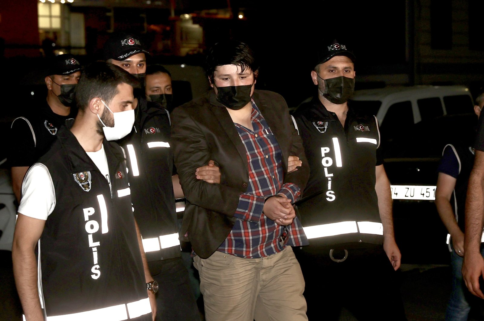 Mehmet Aydın (C) is escorted by police to Istanbul Police Headquarters, Istanbul, Turkey, July 4, 2021. (AA Photo)