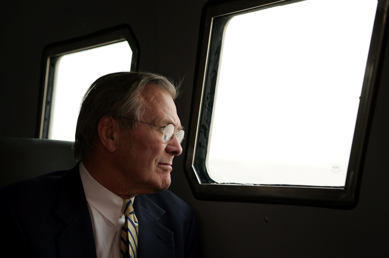 U.S. Secretary of Defense Donald Rumsfeld looks through a window of an armored vehicle while touring Abu Ghraib prison outside Baghdad, Iraq, May 13, 2004. (Reuters Photo)