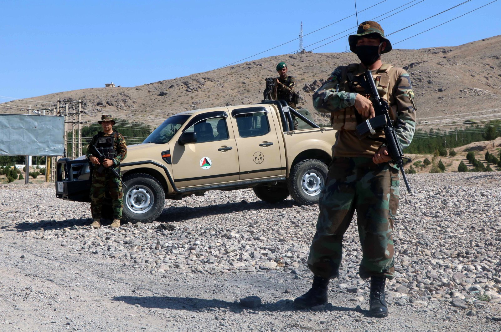 Afghan National Army (ANA) soldiers stand guard on a roadside checkpoint in Herat, Afghanistan, July 3, 2021. (EPA Photo)