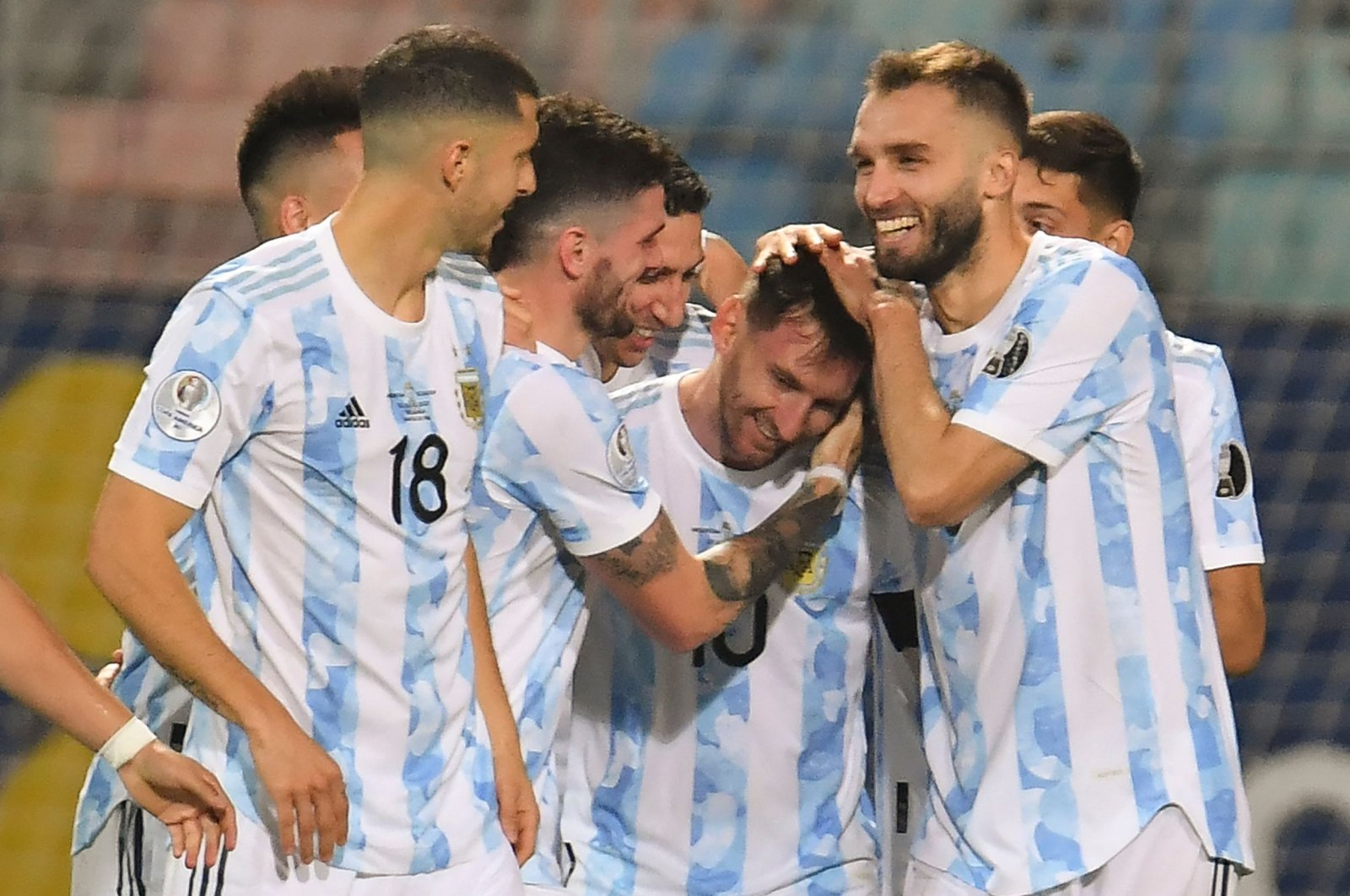 Argentina's Lionel Messi (C) celebrates with teammates after scoring against Ecuador during their 2021 Copa America quarterfinal match at the Olympic Stadium in Goiania, Brazil, July 3, 2021. (AFP Photo)