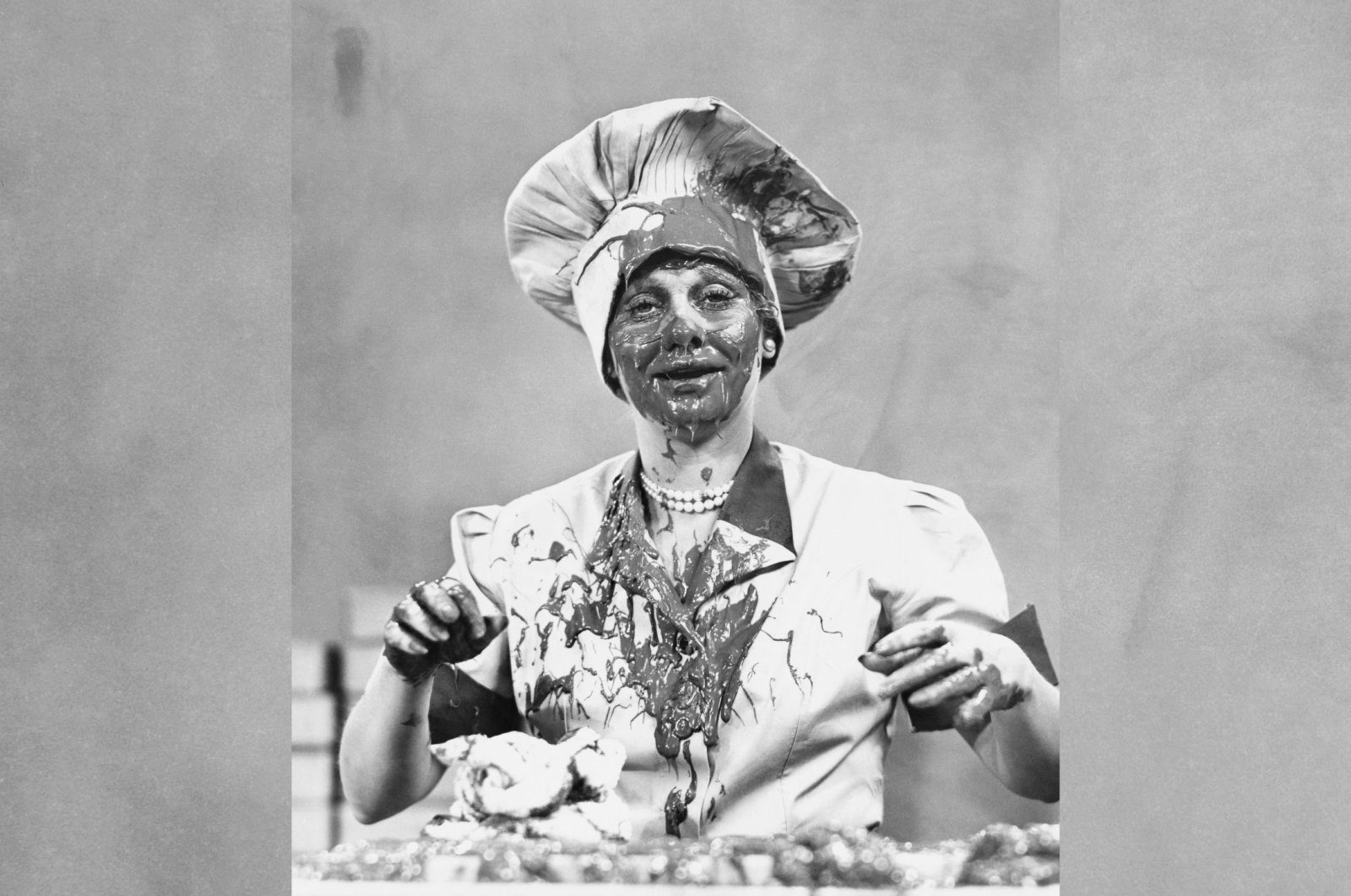 """Actress Lucille Ball stands covered in chocolate in 1952 TV series """"I Love Lucy."""" (Getty Images)"""