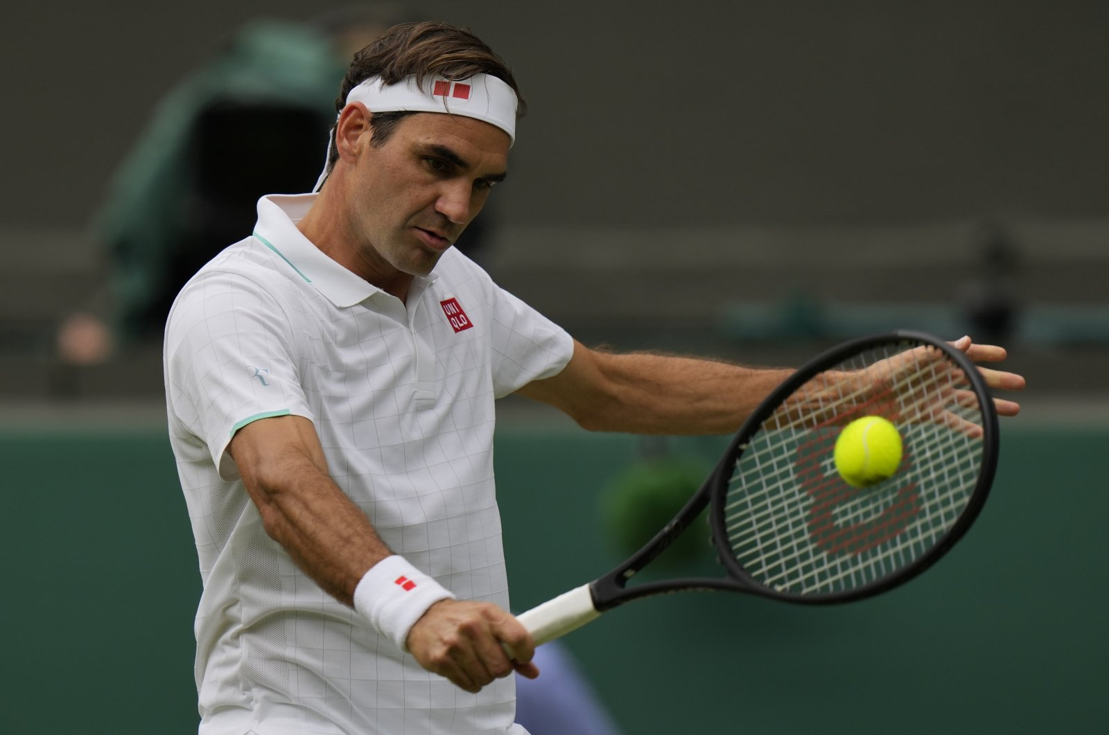 Switzerland's Roger Federer plays a return during the Wimbledon men's singles third-round match against Britain's Cameron Norrie London, England, July 3, 2021. (AP Photo)