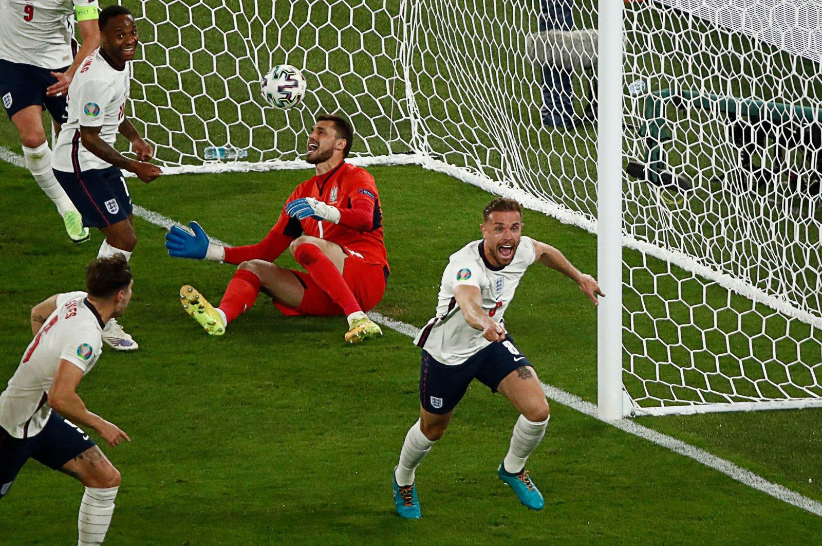 England midfielder Jordan Henderson (R) celebrates scoring the team's fourth goal during the UEFA Euro 2020 quarterfinal match against Ukraine at the Olympic Stadium, Rome, July 3, 2021. (AFP Photo)