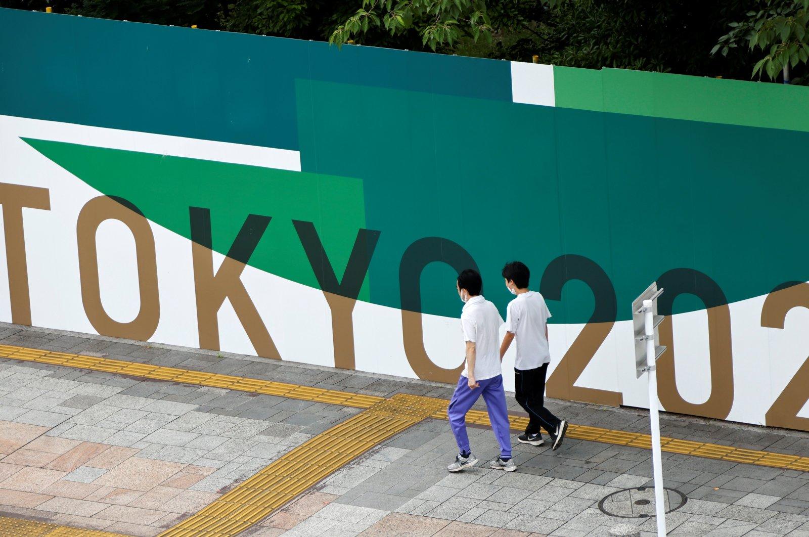 People walk past 2020 Tokyo Olympic Games advertisement banners in Tokyo, Japan, June 27, 2021. (Reuters Photo)