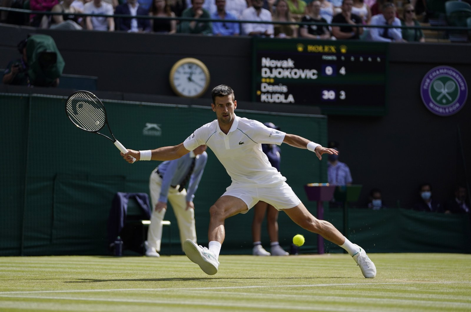 Serbia's Novak Djokovic plays a return to Denis Kudla of the U.S. during the Wimbledon men's singles third round match in London, England, July 2, 2021. (AP Photo)