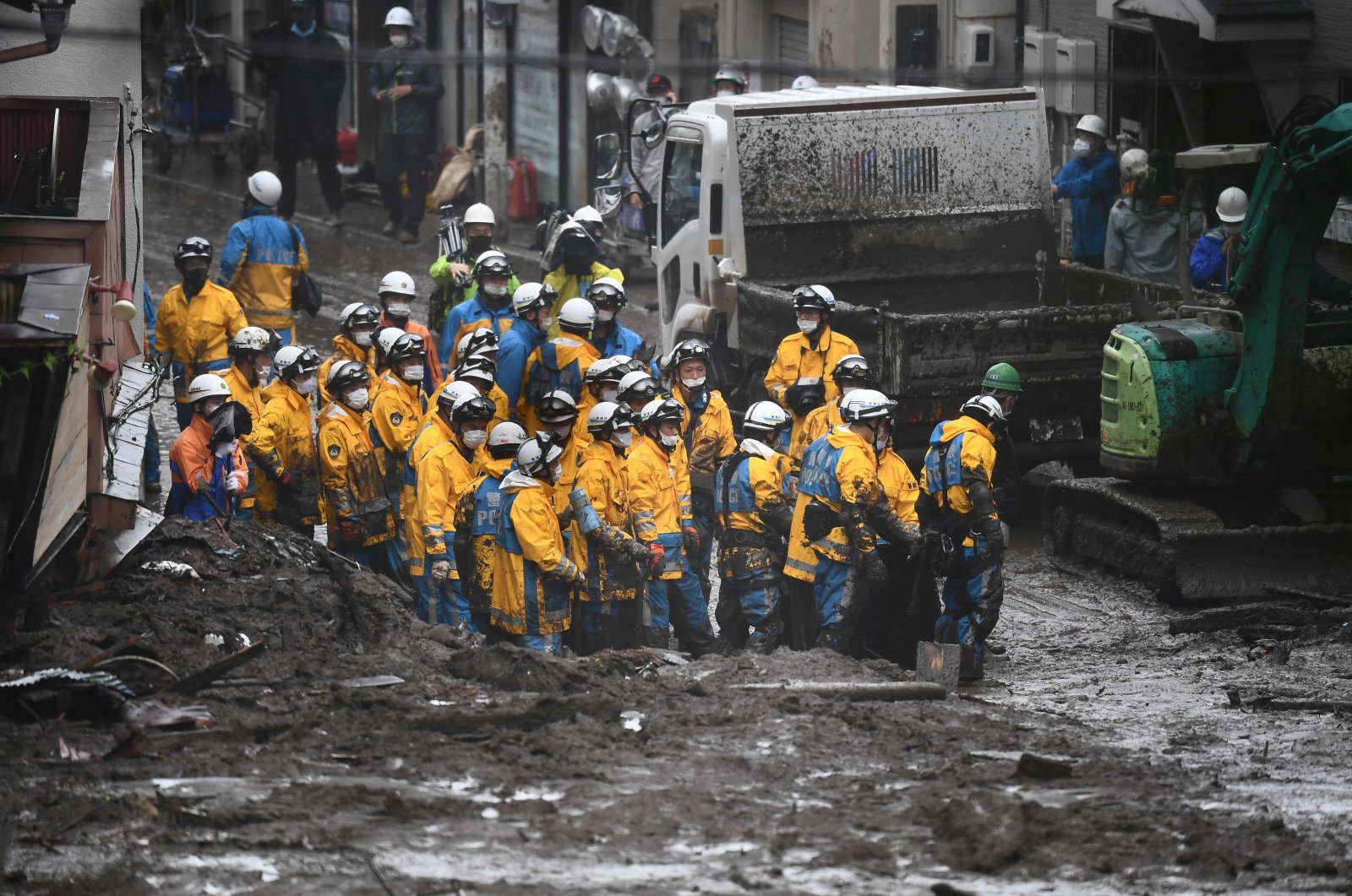 Police work at the scene of a landslide following days of heavy rain in Atami in Shizuoka Prefecture, Japan, July 4, 2021. (AFP Photo)