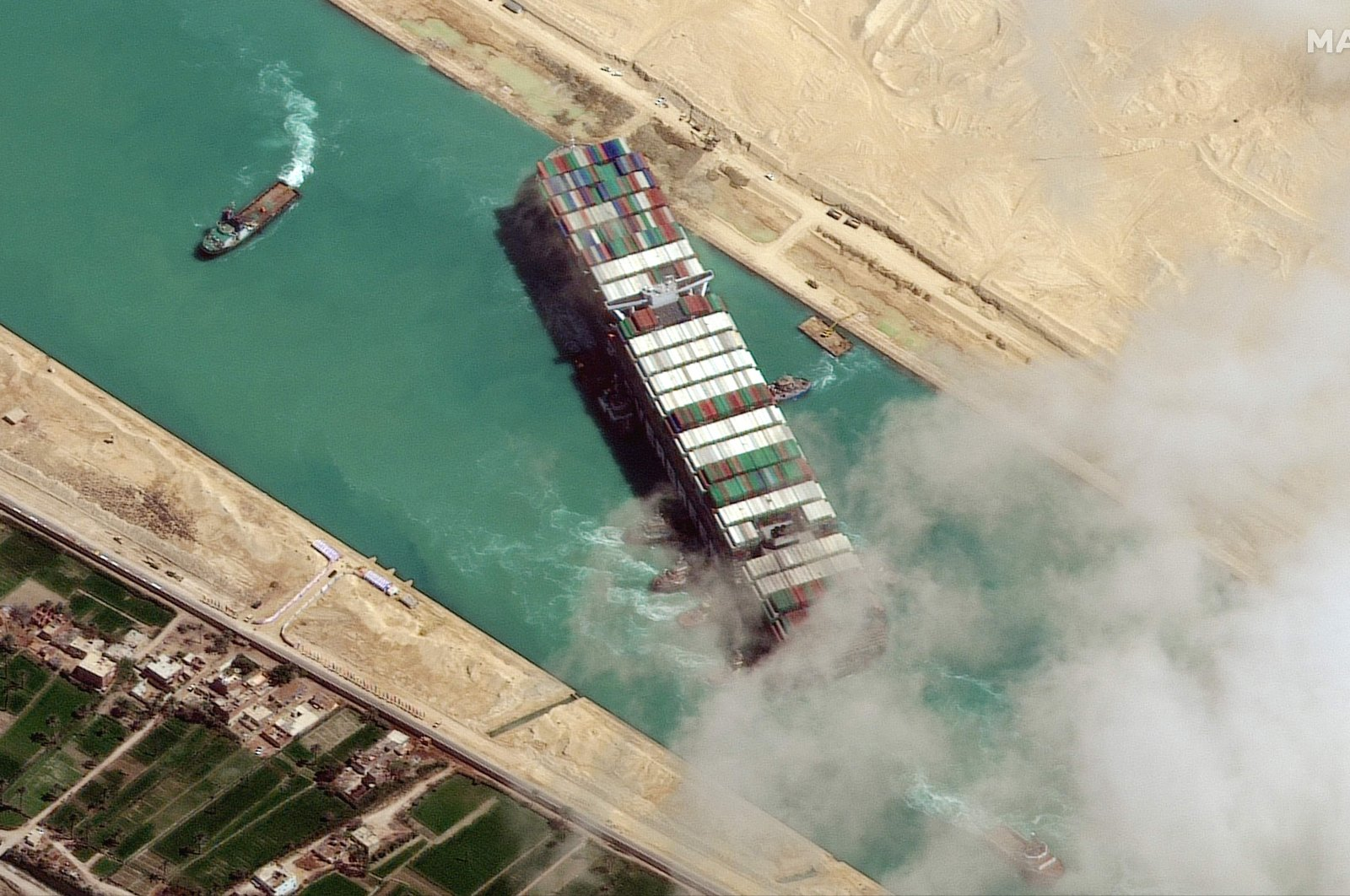 The MV Ever Given container ship is pushed by tugboats in the Suez Canal, Egypt, March 29, 2021. (AFP Photo)