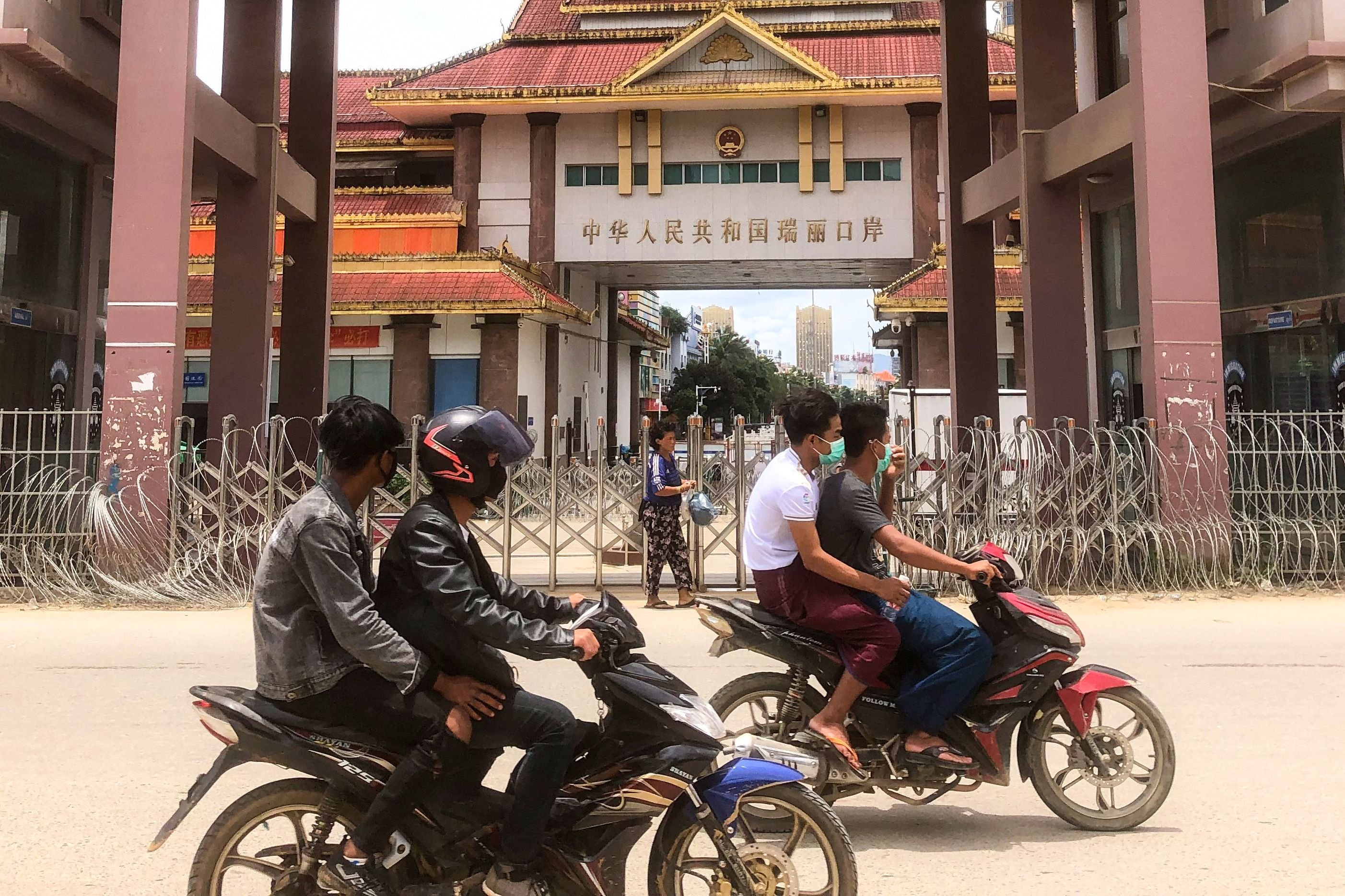Motorists pass the China-Myanmar border gate in Muse in Shan state, July 5, 2021. (AFP Photo)
