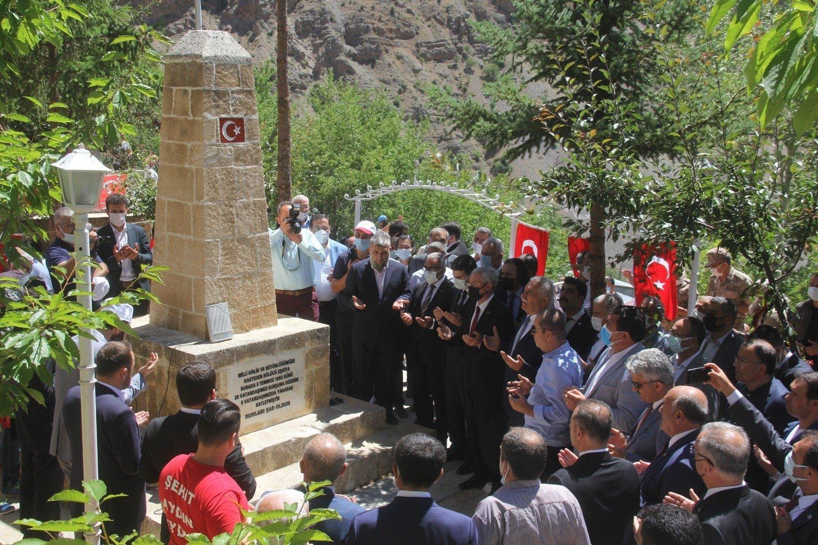 People attend a commemoration ceremony around a memorial to the PKK victims in Başbağlar, Erzincan, eastern Turkey, July 5, 2021. (İHA PHOTO)