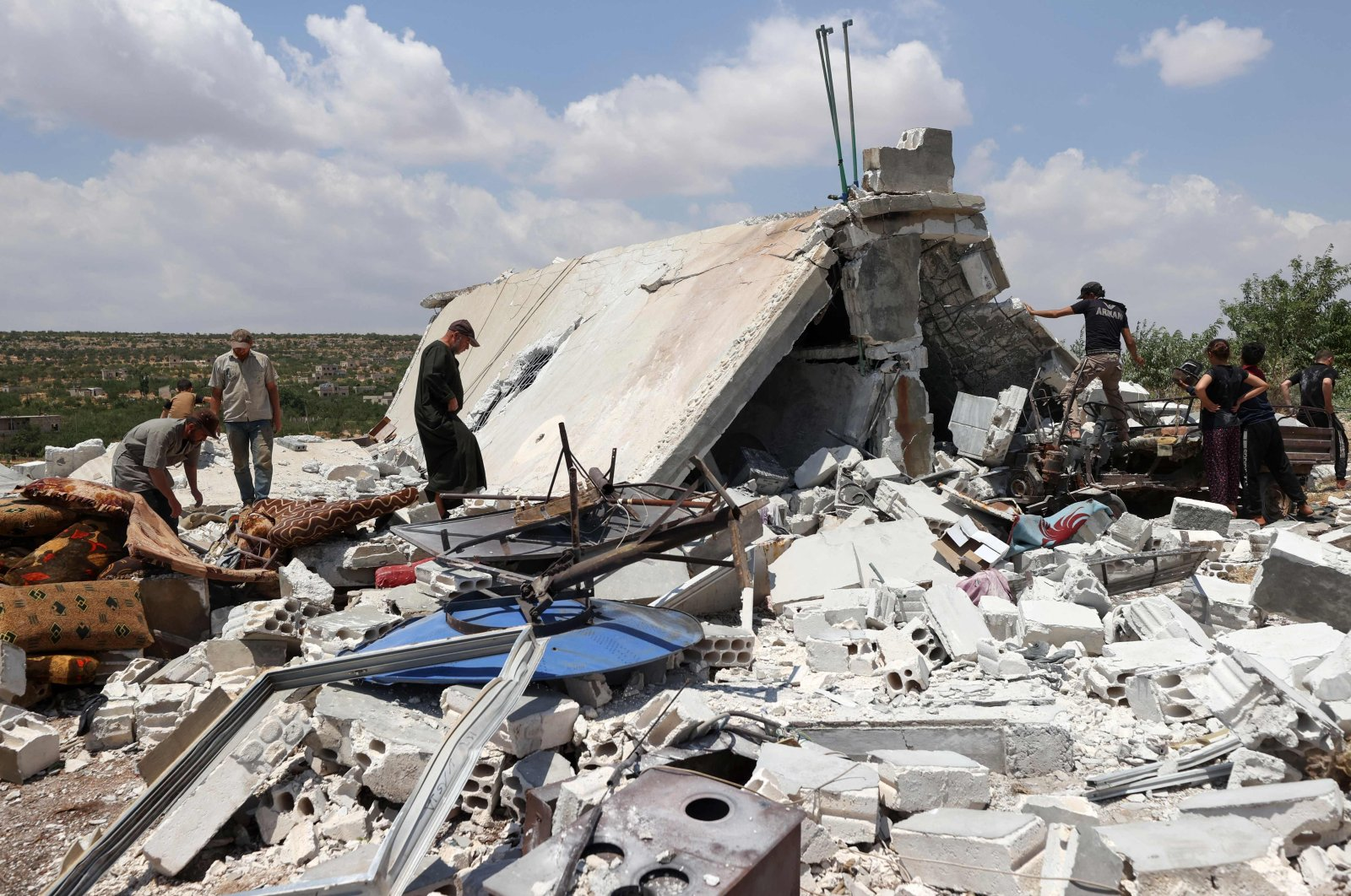 People salvage belongings from a house destroyed by a Russian missile attack in the Jabal al-Zawiya region in opposition-held Idlib province, Syria, July 4, 2021. (AFP Photo)
