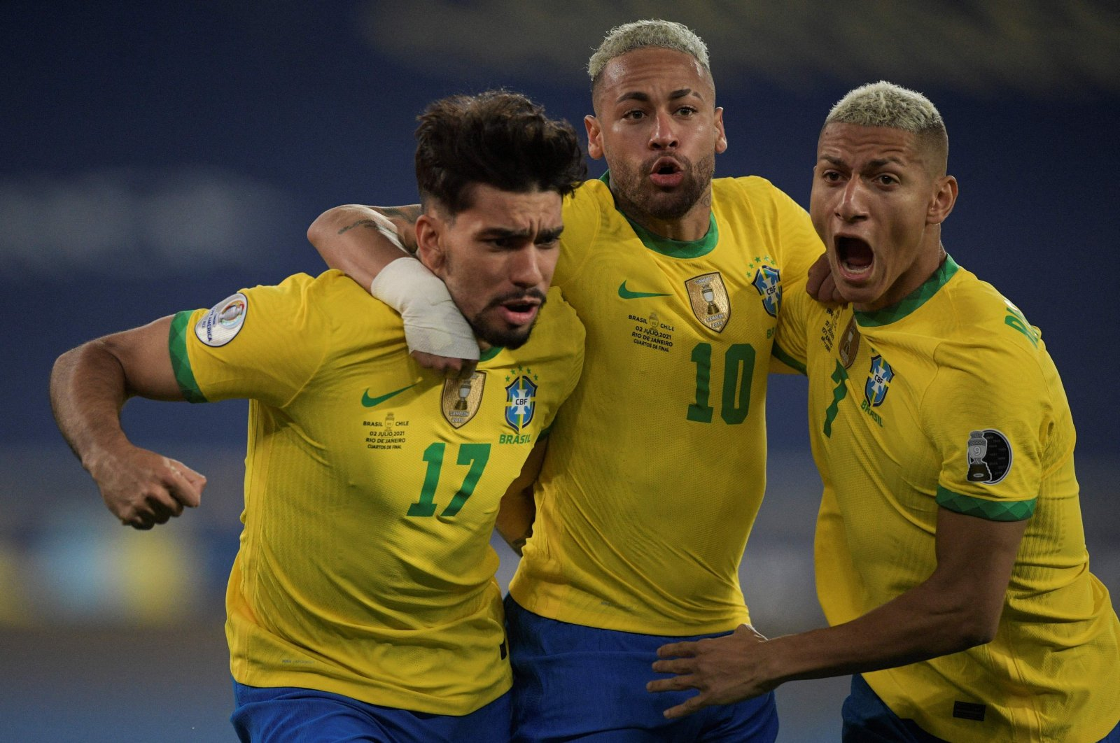 Brazil's Lucas Paqueta (L) celebrates with Neymar (C) and Richarlison after scoring against Chile during their 2021 Copa America quarterfinal at the Nilton Santos Stadium in Rio de Janeiro, Brazil, July 2, 2021. (AFP Photo)