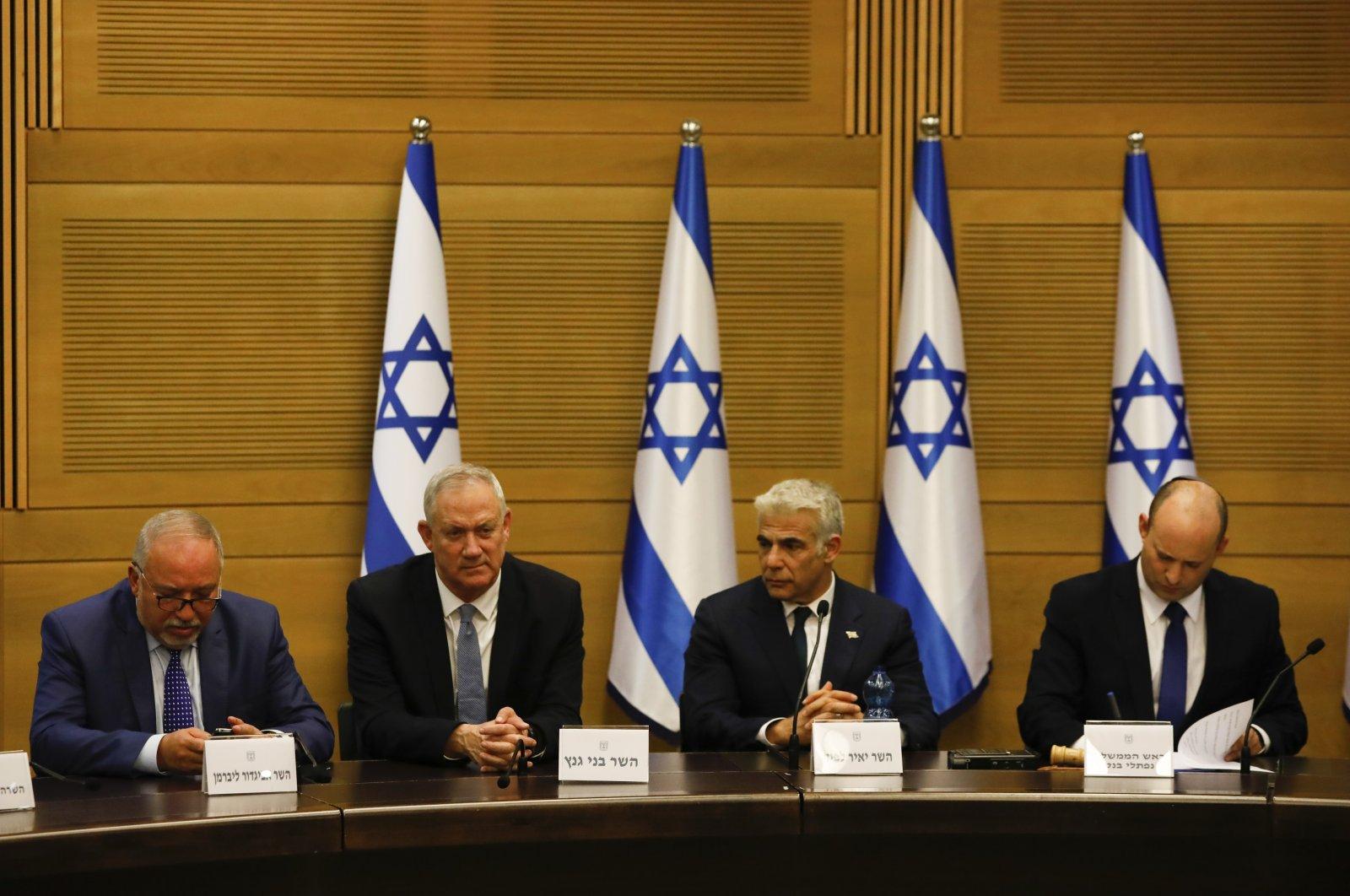 From left to right,  Avigdor Lieberman, Benny Gantz, Yair Lapid and Israeli Prime Minister Naftali Bennett hold a cabinet meeting. (AP Photo File Photo)