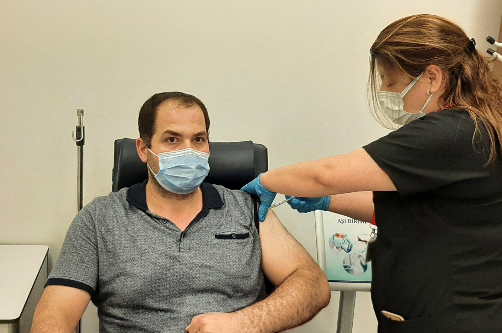 Hüseyin Polat, a volunteer, gets vaccinated with Turkovac, in the capital Ankara, Turkey, June 24, 2021. (AA PHOTO)
