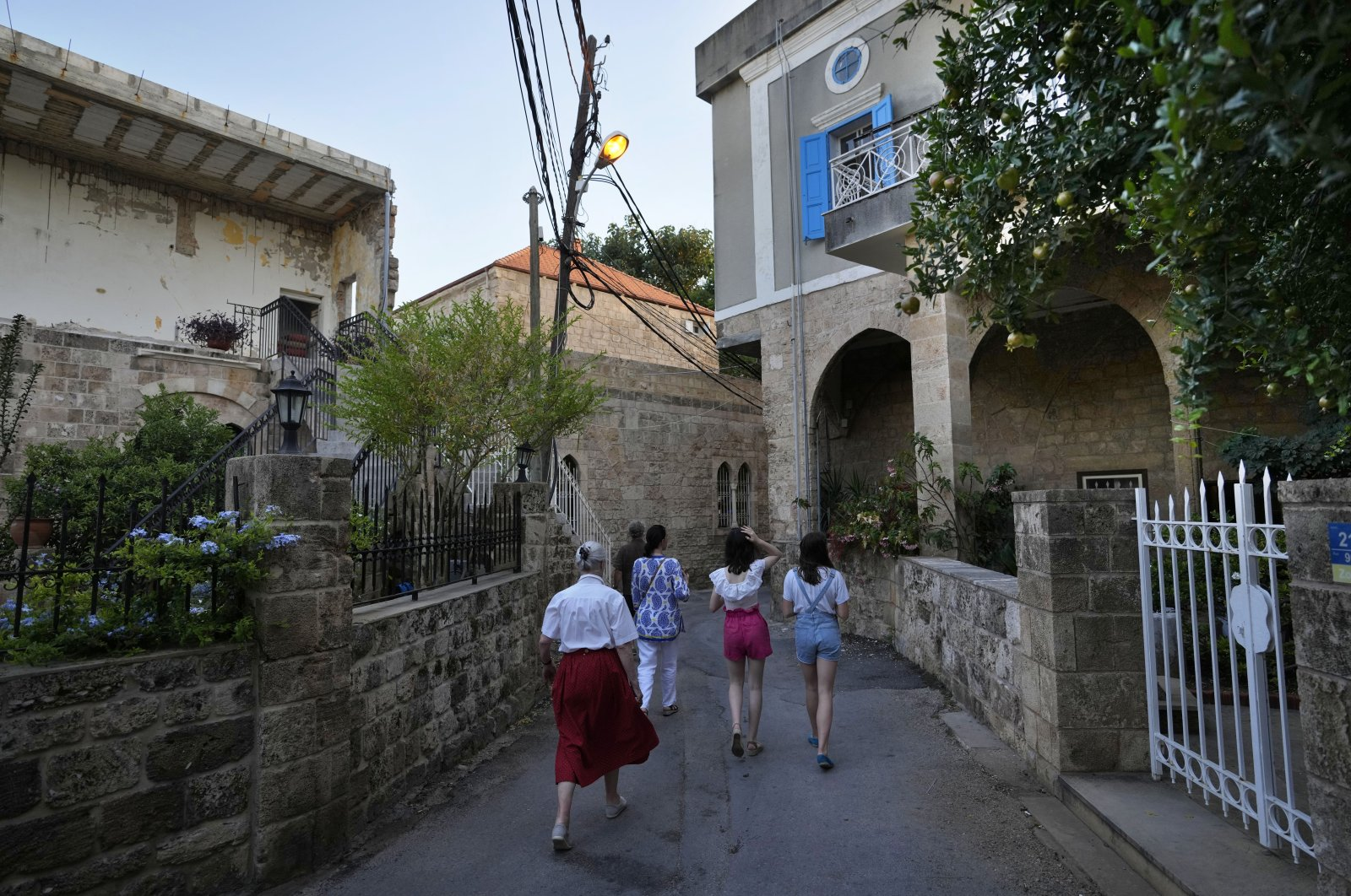 Tourists visit Batroun village, north of Beirut, Lebanon, Friday, July 2, 2021. (AP Photo)
