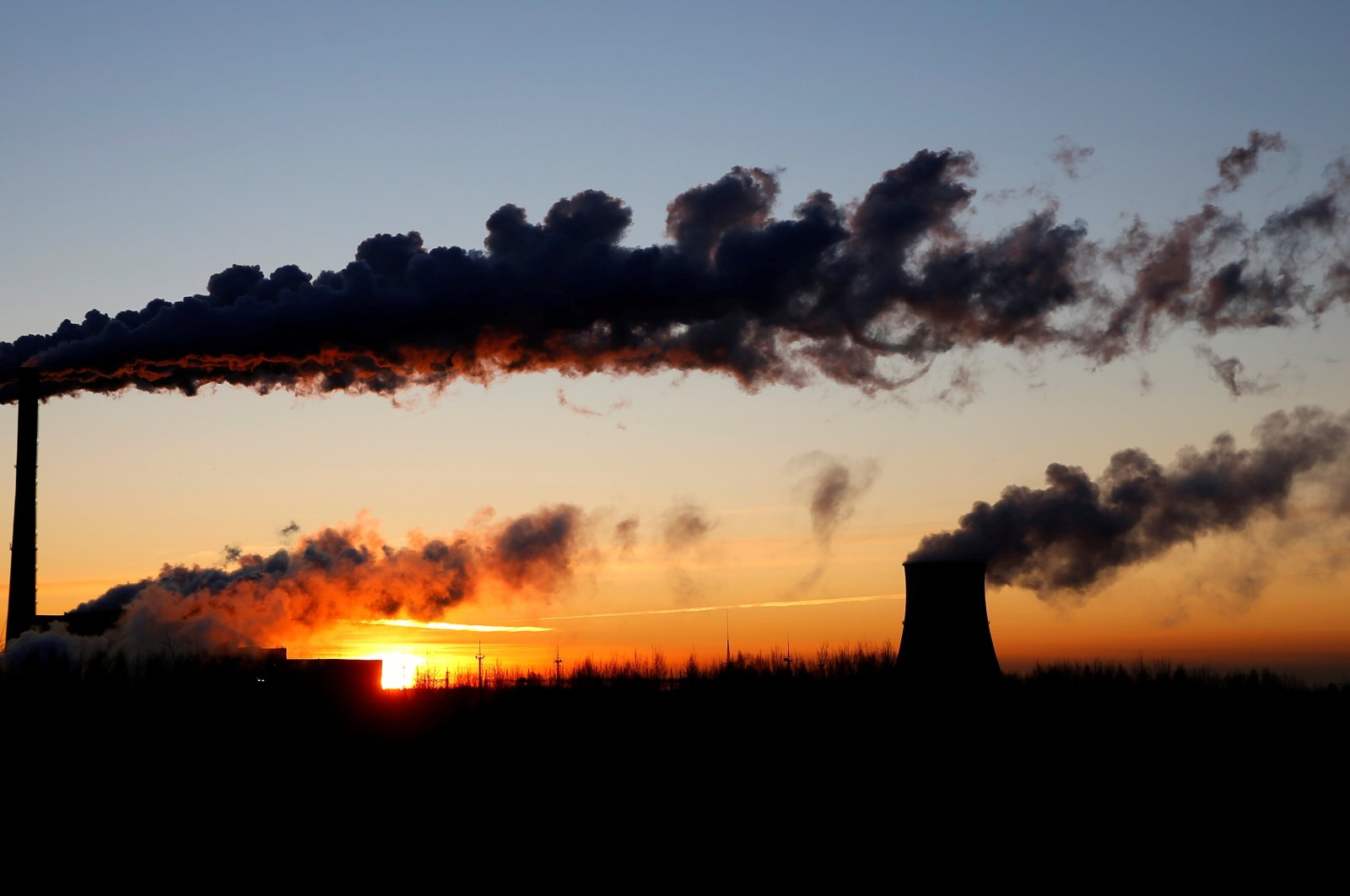 The sun rises behind a gas-fired power station in Minsk, Belarus, Feb. 5, 2020.  (Reuters Photo)