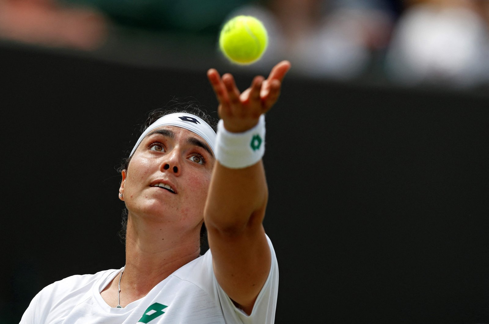 Tunisia's Ons Jabeur serves against Poland's Iga Swiatek during a fourth-round Wimbledon match in London, England, July 5, 2021. (AFP Photo)