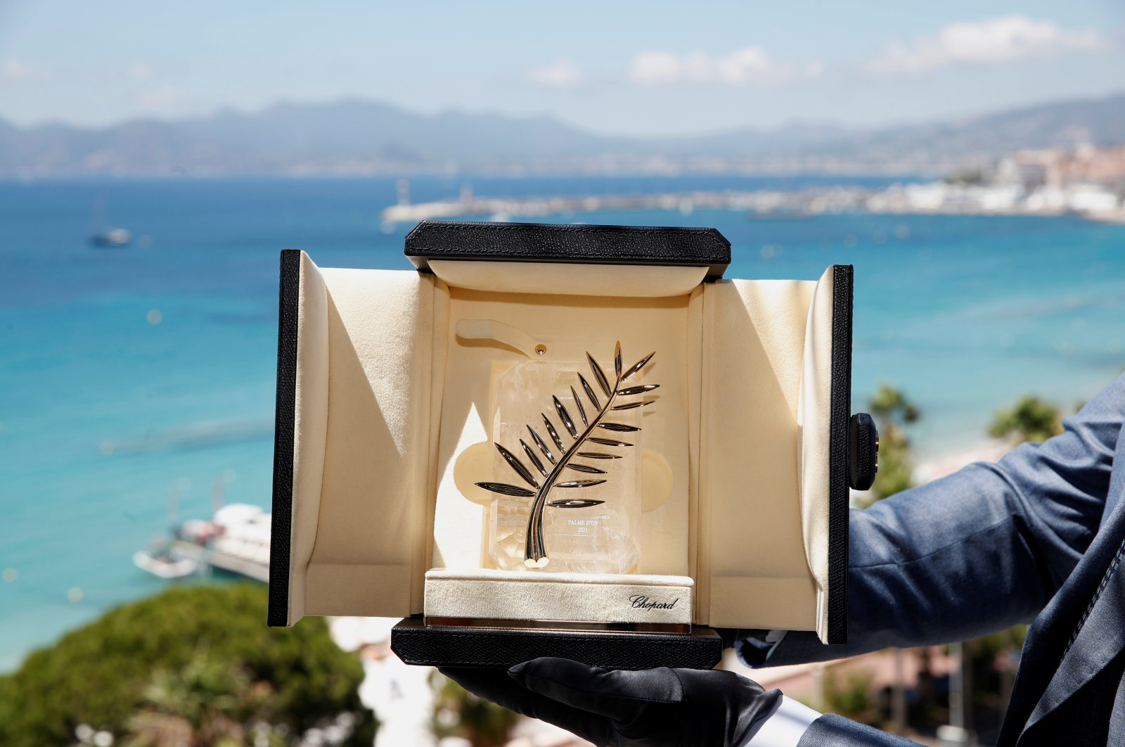 A Chopard representative displays the Palme d'Or, the highest prize awarded to competing films, during an interview before the start of film festival, Cannes, France, July 5, 2021. (Reuters Photo)