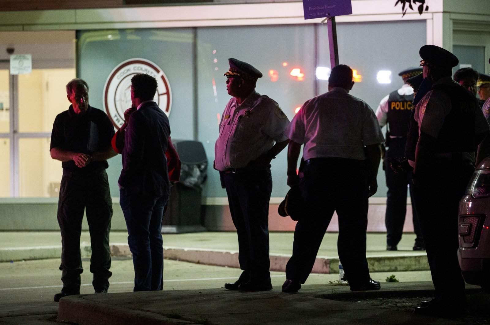 Police gather outside Stroger Hospital where two officers were brought after being shot while dispersing a crowd on the 100 block of North Long Avenue during the Fourth of July long-weekend in the early hours of Monday, July 5, 2021, Chicago, U.S. (Chicago Tribune via AP)