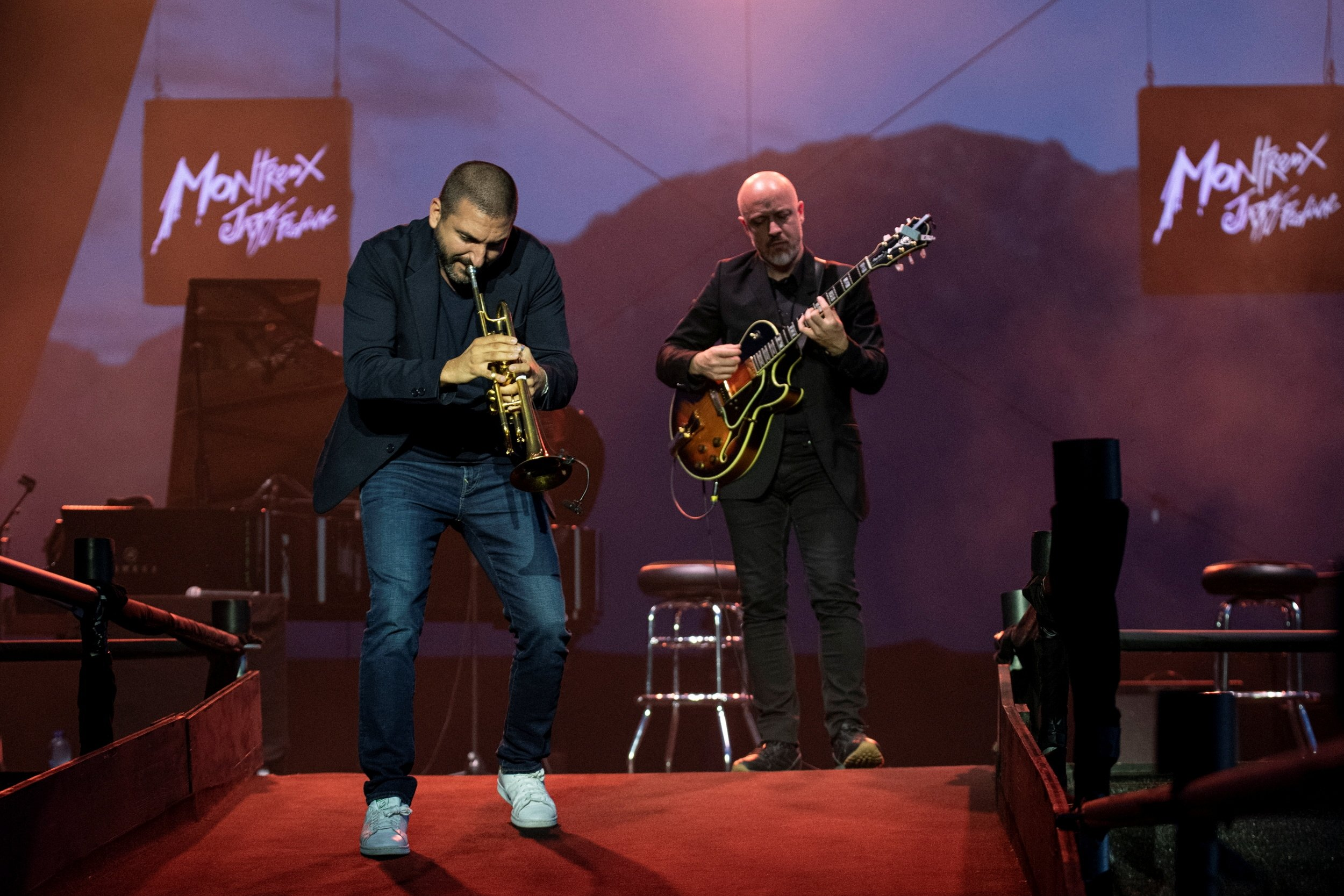 French-Lebanese trumpeter Ibrahim Maalouf (L) and Belgian guitar player Francois Delporte perform for a limited number of fans during the 55th Montreux Jazz Festival in Montreux, Switzerland, July 5, 2021. (Reuters Photo)