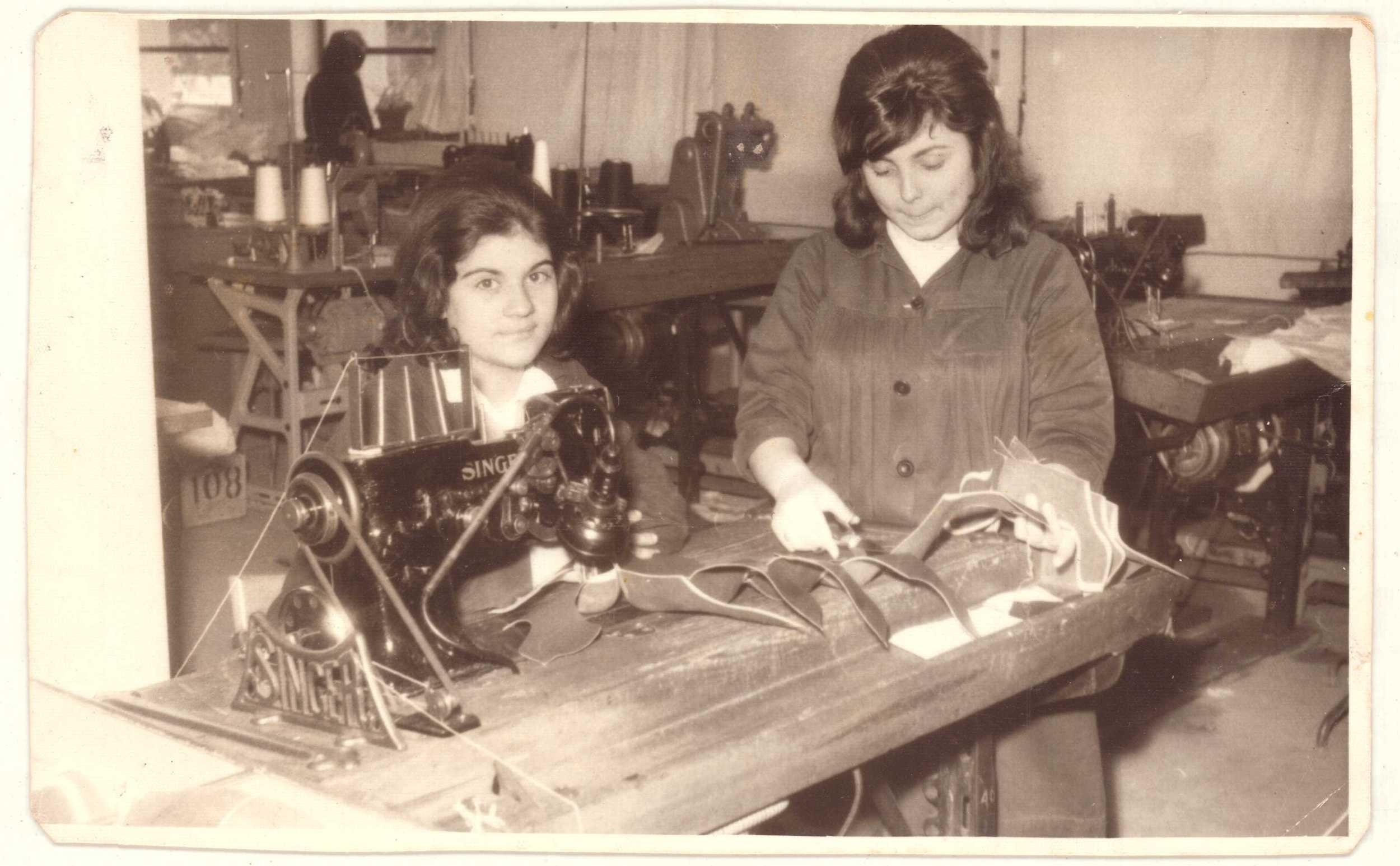 An old photo shows two women workers during their shift in Sümerbank Beykoz Leather and Shoe Factory from 'Kundura Memory' exhibition.