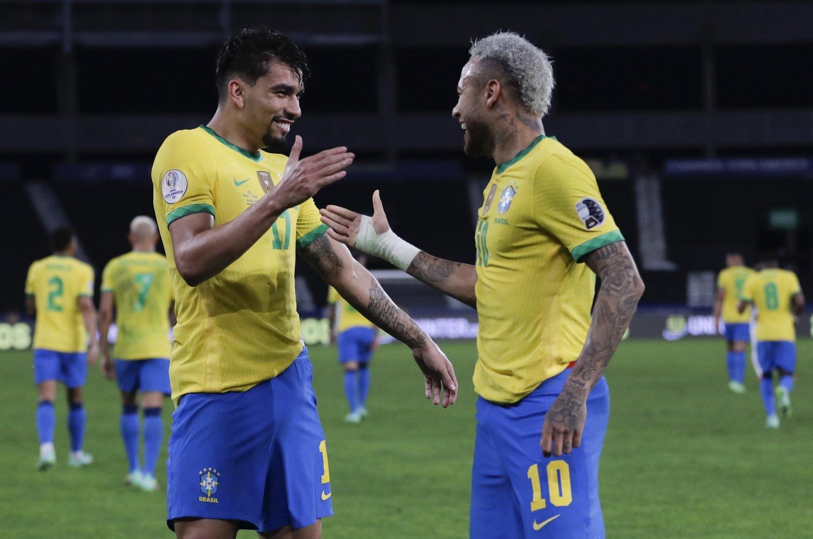Brazil's Lucas Paqueta (L) celebrates with teammate Neymar after scoring his side's opening goal in the Copa America semifinal against Peru at Nilton Santos stadium in Rio de Janeiro, Brazil, July 5, 2021. (AP Photo)