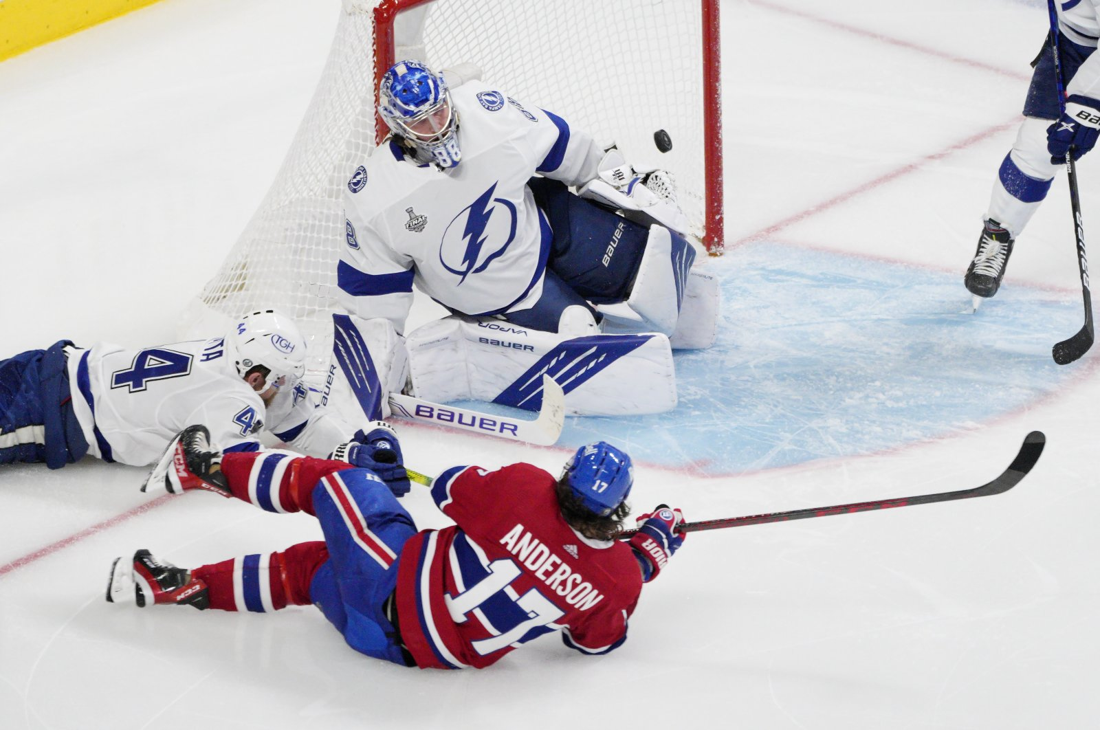 Montreal Canadiens Josh Anderson (2nd L) scores past Tampa Bay Lightning goaltender Andrei Vasilevskiy (2nd R) during overtime of Game 4 of the Stanley Cup final in Montreal, Canada, July 5, 2021. (AP Photo)
