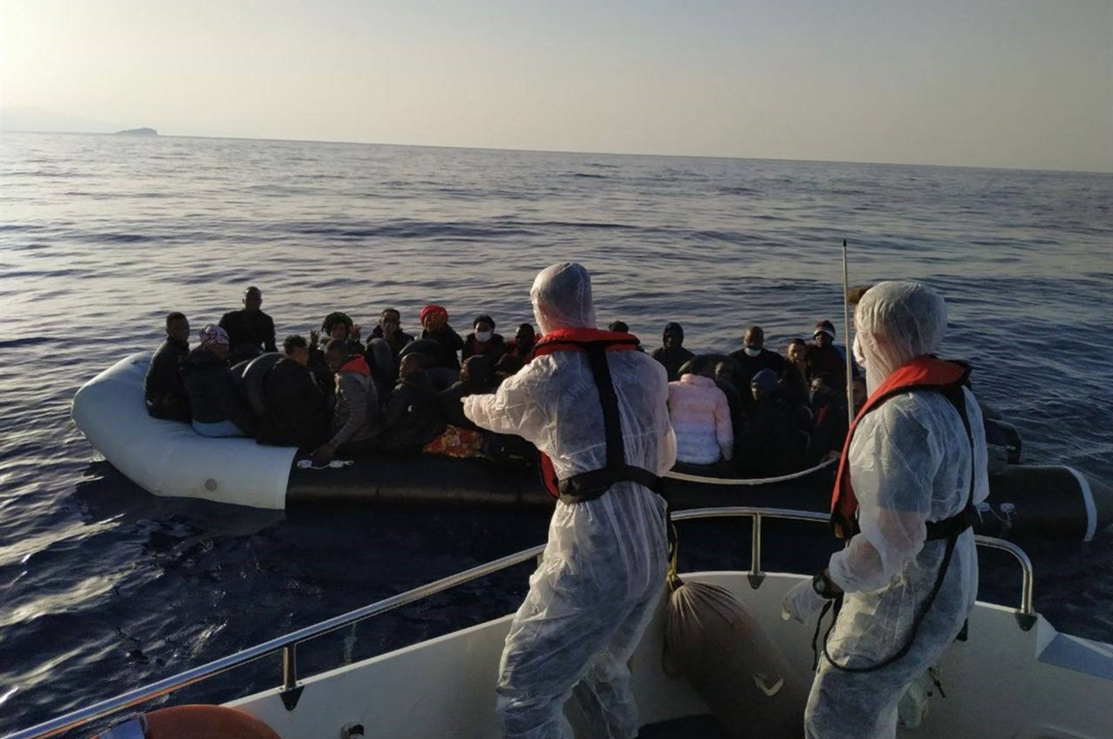 Turkish coast guard units rescue irregular migrants pushed back by Greece in the Çeşme district of western Izmir province, Turkey, July 5, 2021. (AA Photo)