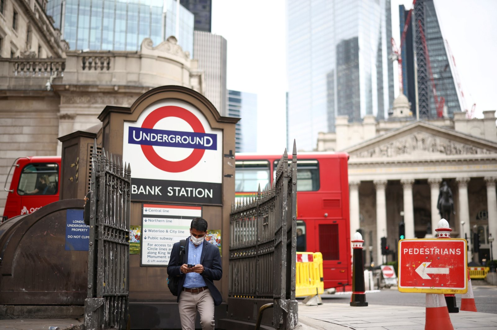 A person exits the Bank underground station in the City of London financial district in London, U.K., June 11, 2021. (Reuters Photo)