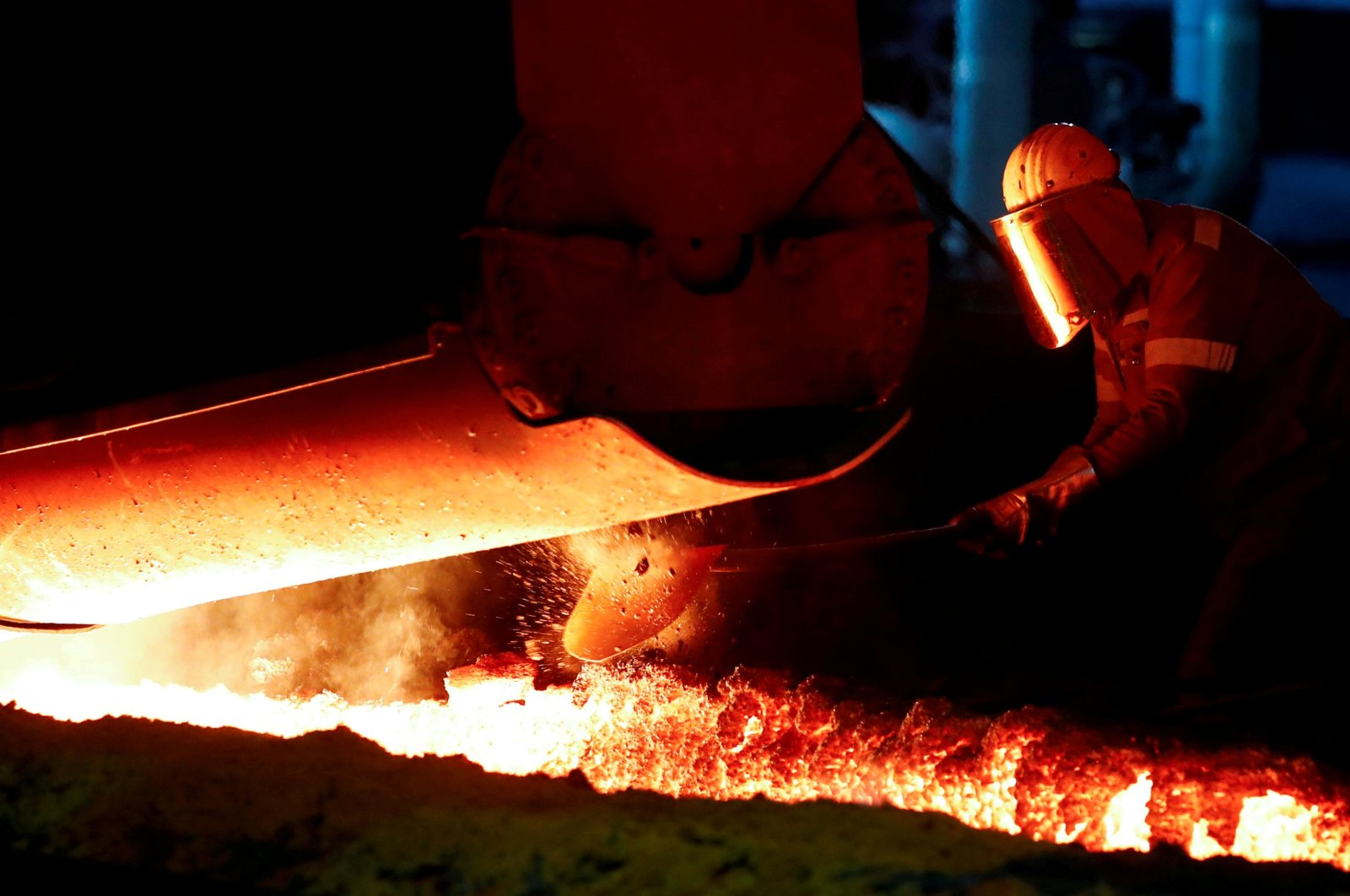 A steelworker of Germany's industrial conglomerate ThyssenKrupp AG works near a blast furnace at Germany's largest steel mill in Duisburg, Germany, Jan. 28, 2019. (Reuters Photo)