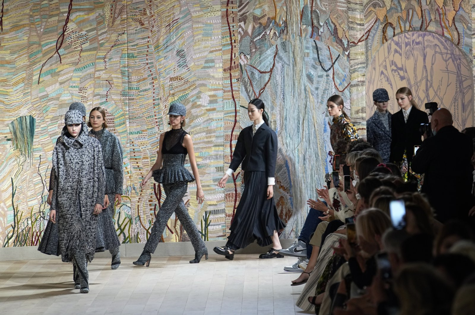 Models wear creations for Dior's Haute Couture Fall-Winter 2021-2022 fashion collection presented in Paris, France, July 5, 2021. (AP Photo)