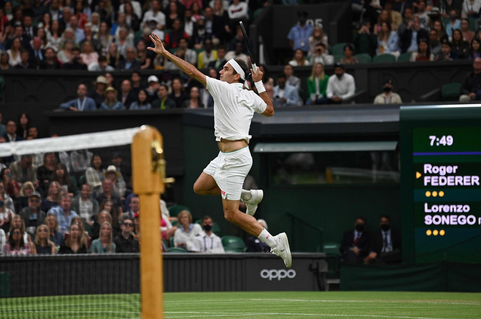 Switzerland's Roger Federer jumps to play a return against Italy's Lorenzo Sonego during their Wimbledon fourth-round men's singles match, London, England, July 5, 2021. (AFP Photo)