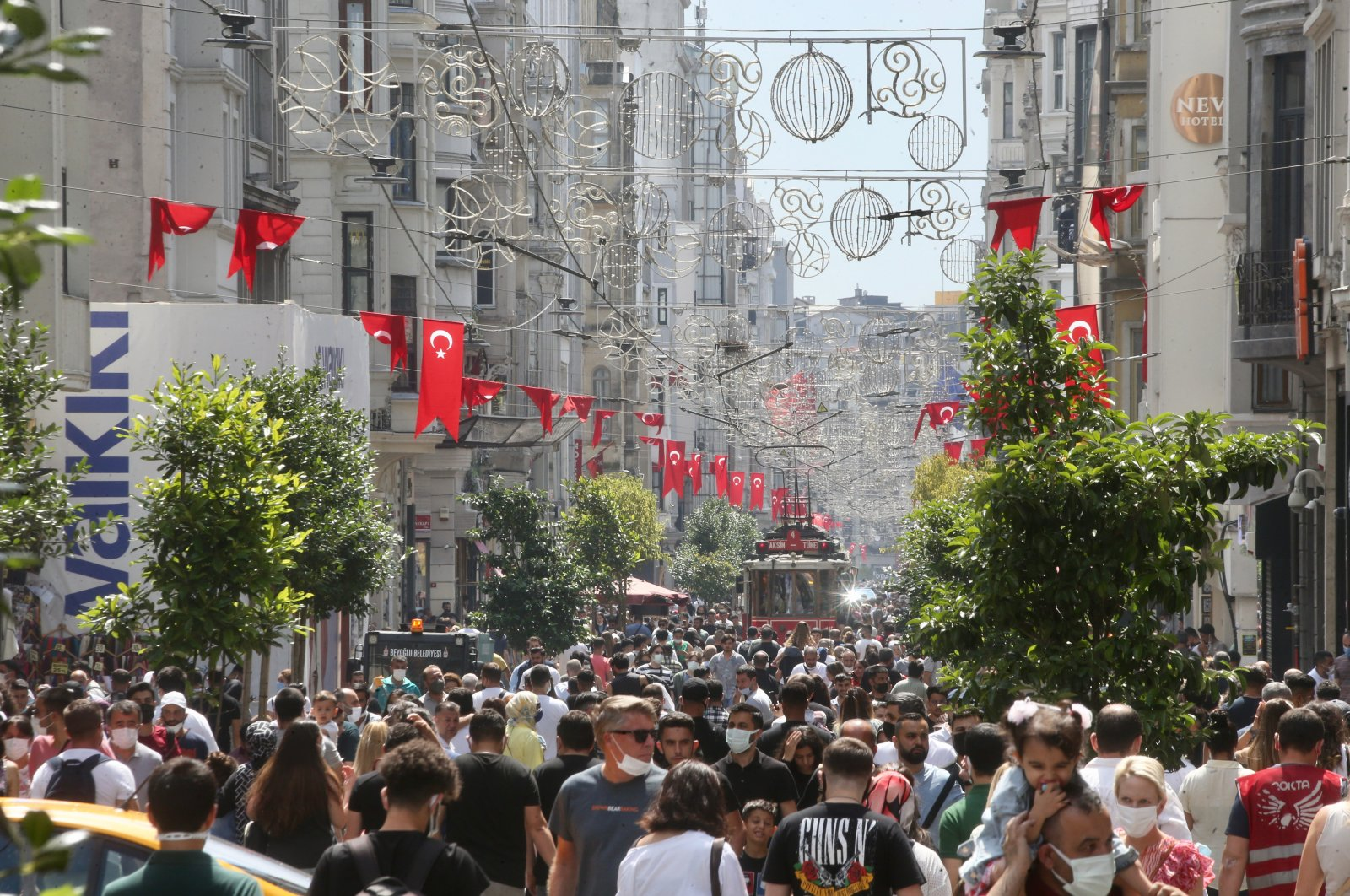 People walk on Istiklal Avenue in Istanbul, Turkey, July 4, 2021. (AA PHOTO)