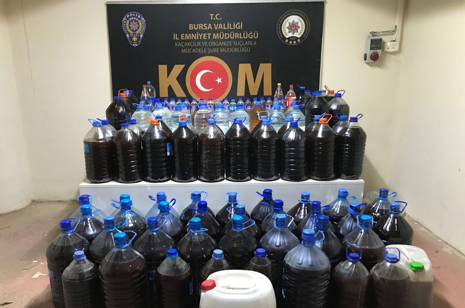 Police display bootleg alcohol seized at an operation in an illegal brewery, in Bursa, northwestern Turkey, July 1, 2021. (İHA PHOTO)